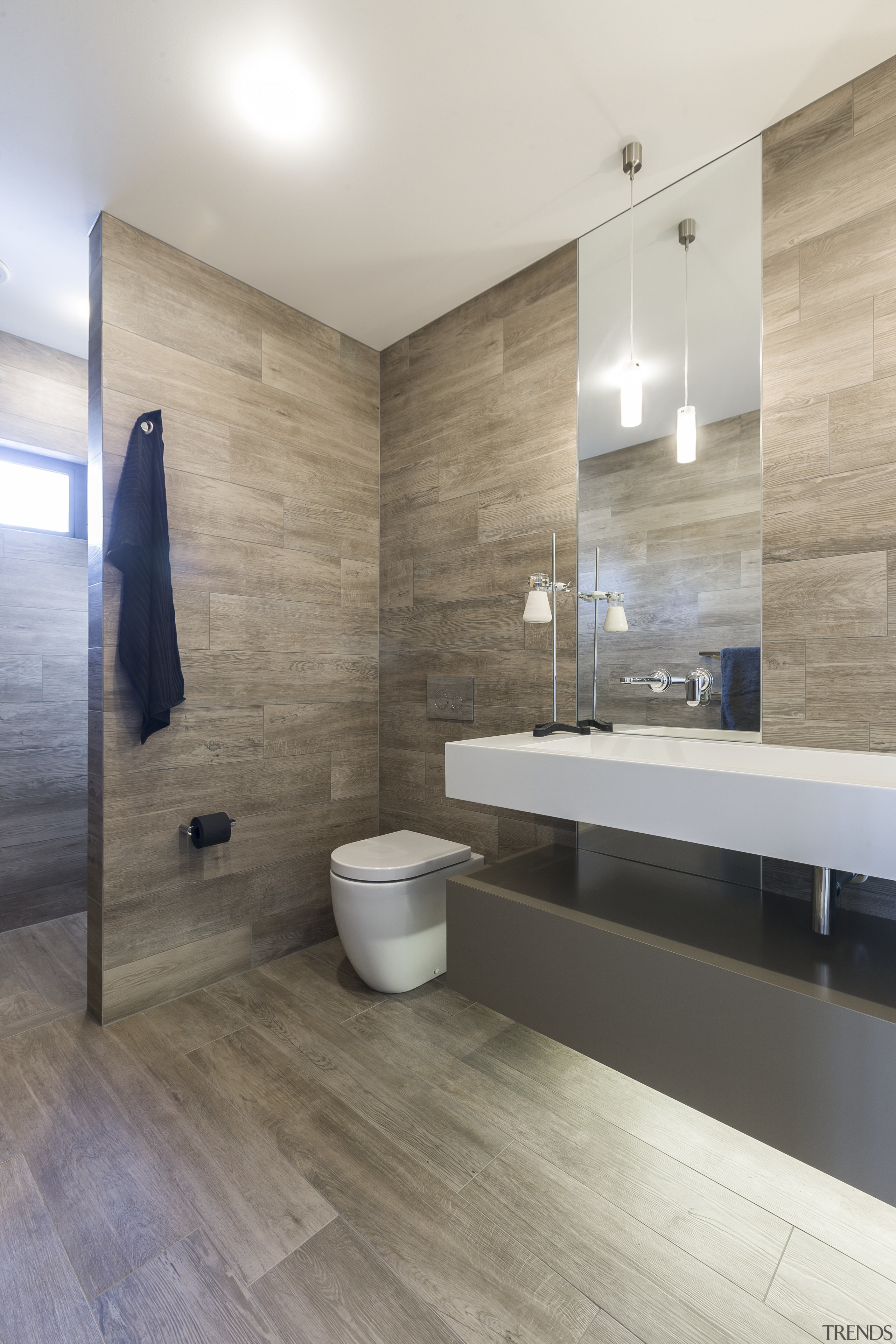 A blade wall provides a bold and private architecture, bathroom, floor, flooring, hardwood, home, interior design, laminate flooring, real estate, room, sink, tile, wall, wood, wood flooring, gray