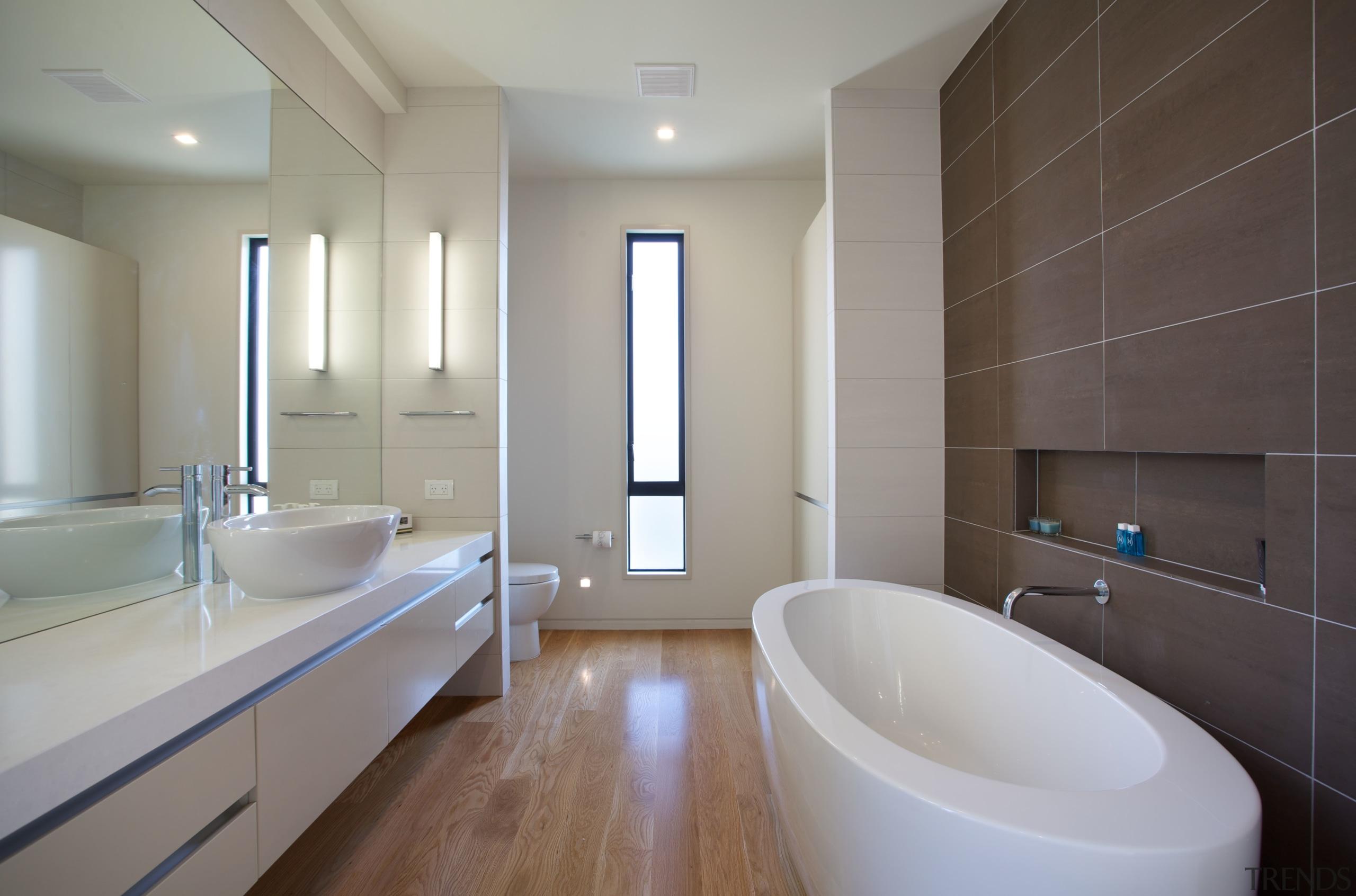 Resort-style contemporary ensuite bathroom - Resort-style contemporary ensuite architecture, bathroom, daylighting, floor, home, interior design, property, real estate, room, sink, tile, wall, window, gray