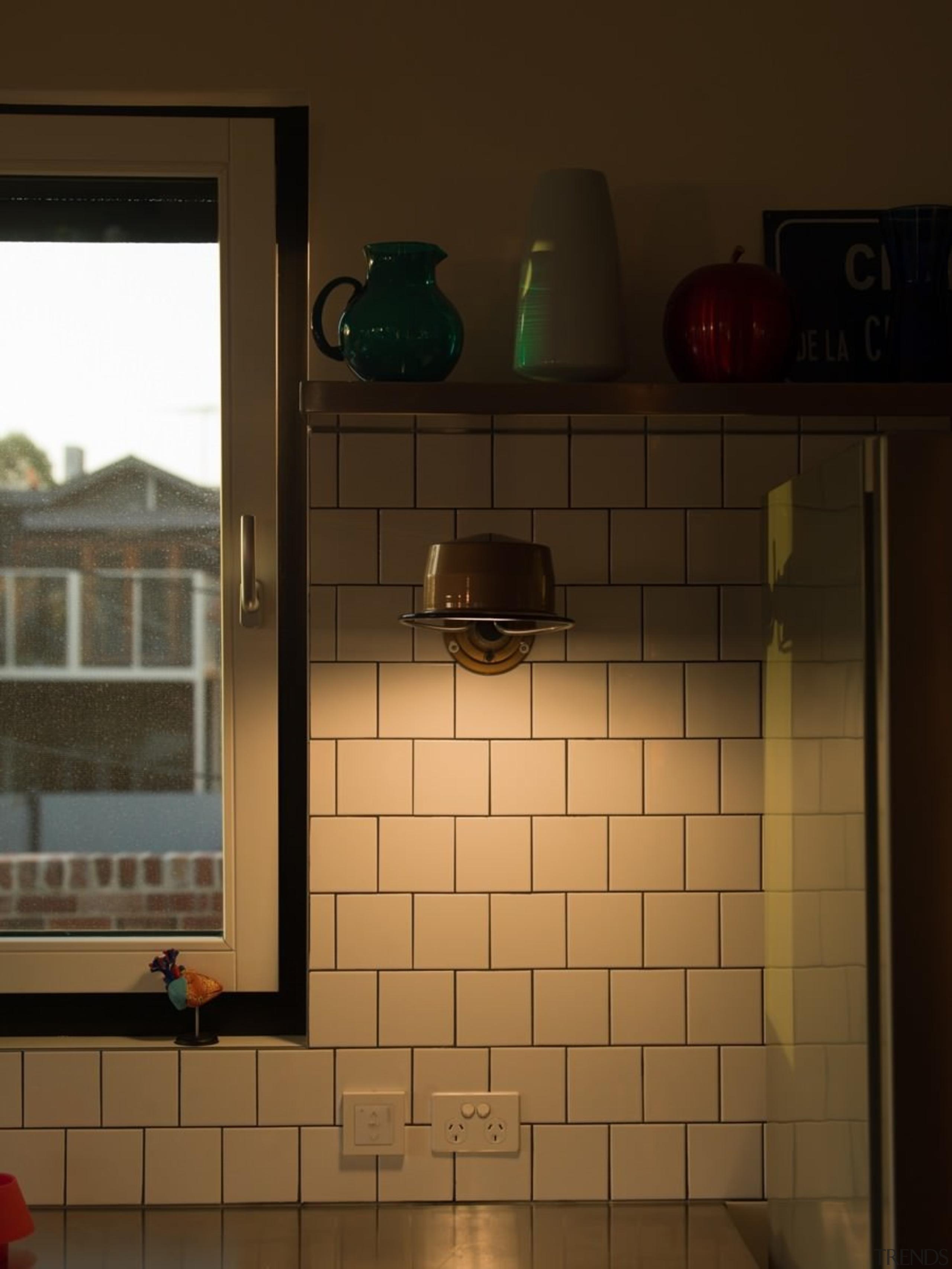 White tiles create a diner-like splashback - White house, light, light fixture, lighting, wall, window, wood, brown