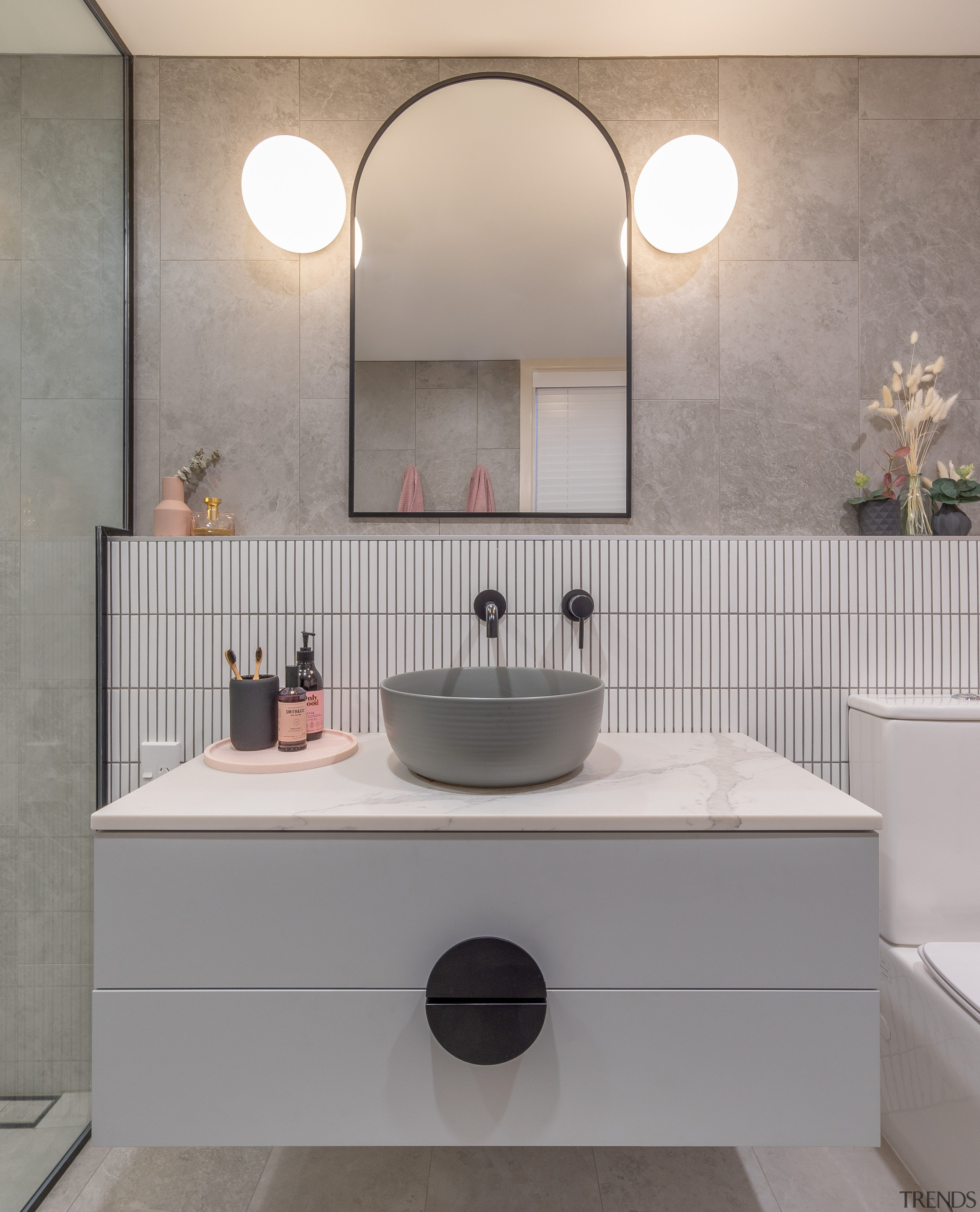 The stone vanity top and soft grey basin