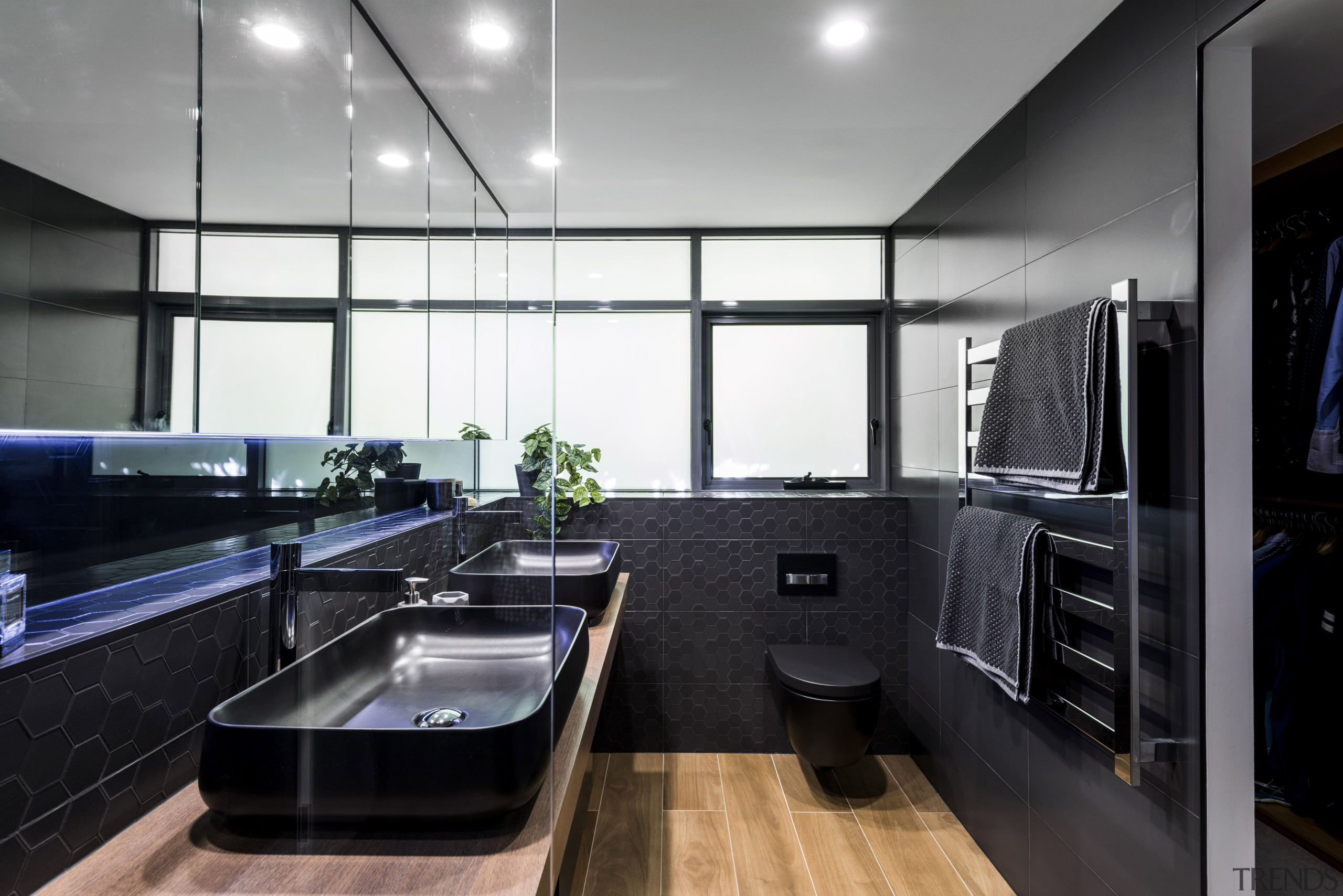 This comprehensively reinvented master ensuite in a penthouse countertop, interior design, kitchen, real estate, room, black