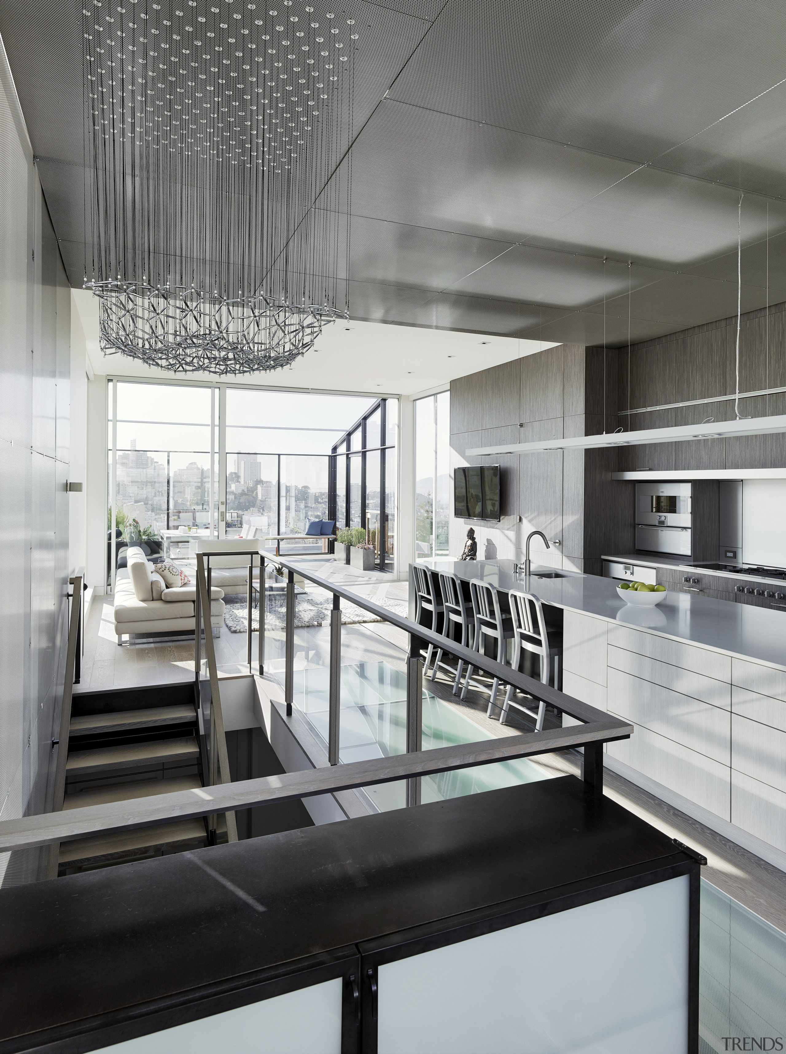 A custom kinetic sculpture by Reuben Margolin enlivens architecture, condominium, daylighting, house, interior design, kitchen, gray, black, white