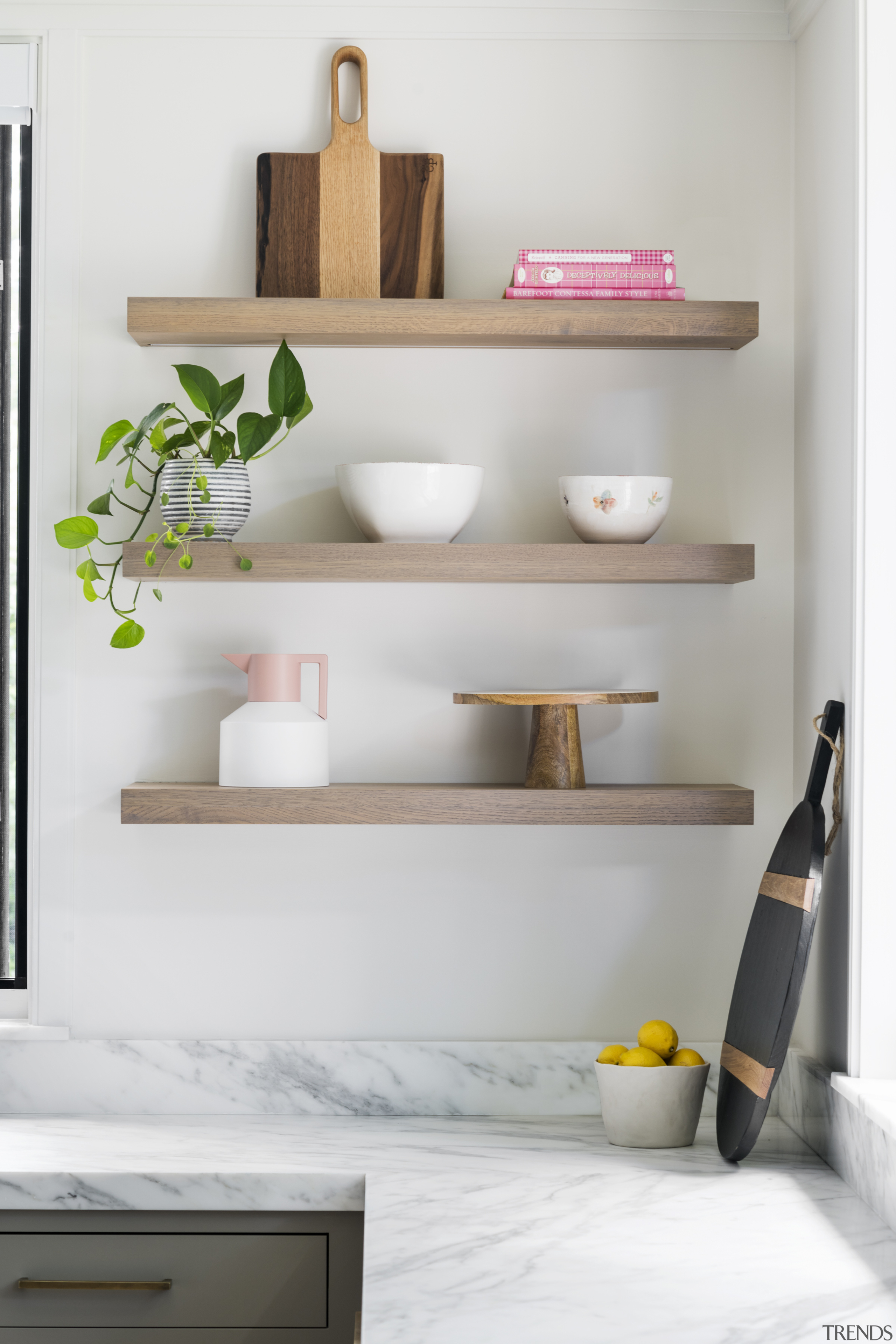 Open oak display shelving contributes to the light