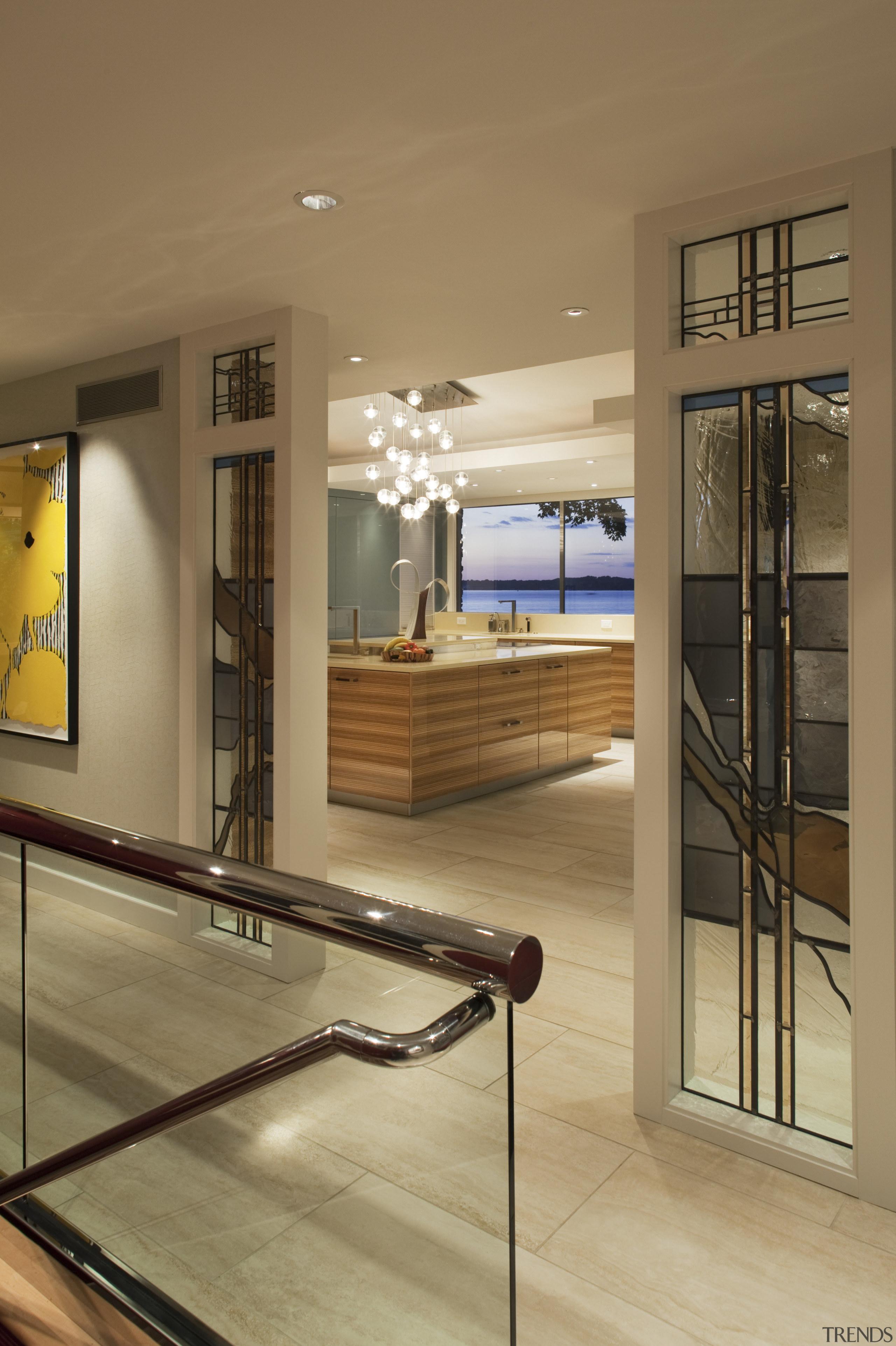 View fo kitchen remodelled with Zebrano Vaneer.  floor, flooring, glass, home, interior design, lobby, window, wood, brown, orange