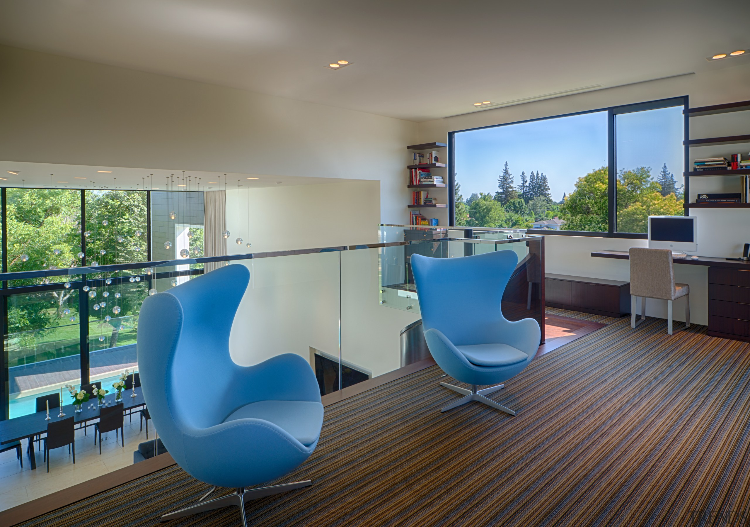 The mezzanine home office also provides an alternative apartment, architecture, floor, home, house, interior design, living room, real estate, gray