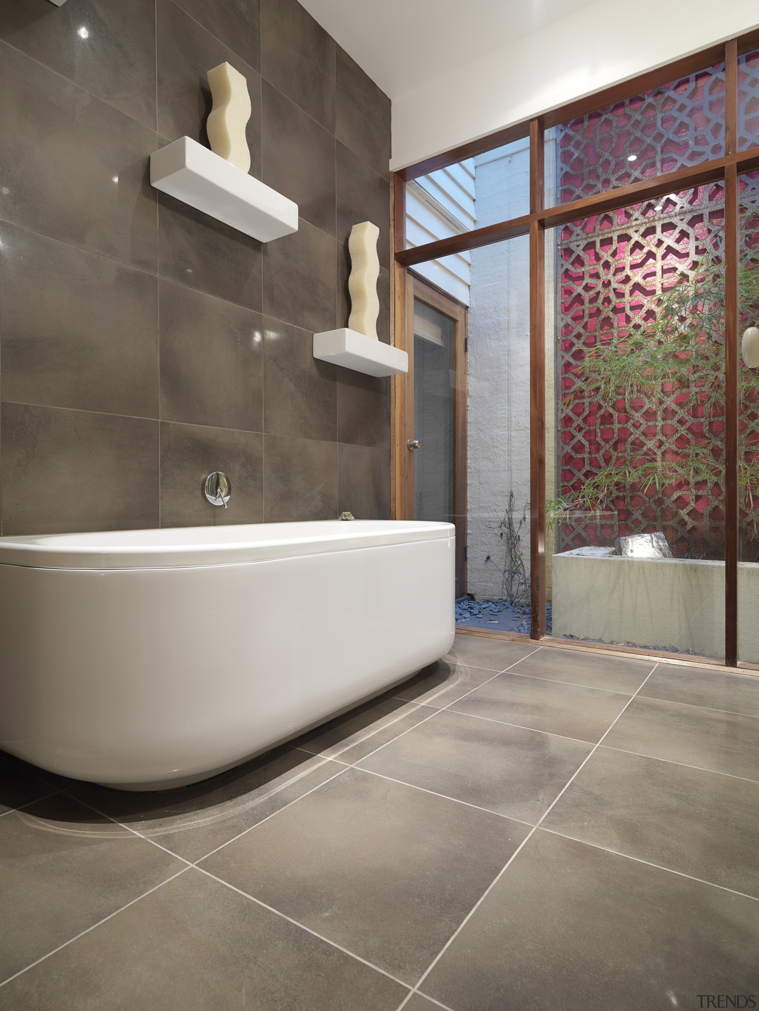 View of renovated bathroom, featuring bathtub, ceramic tiled bathroom, floor, flooring, interior design, room, tile, wall, gray, brown