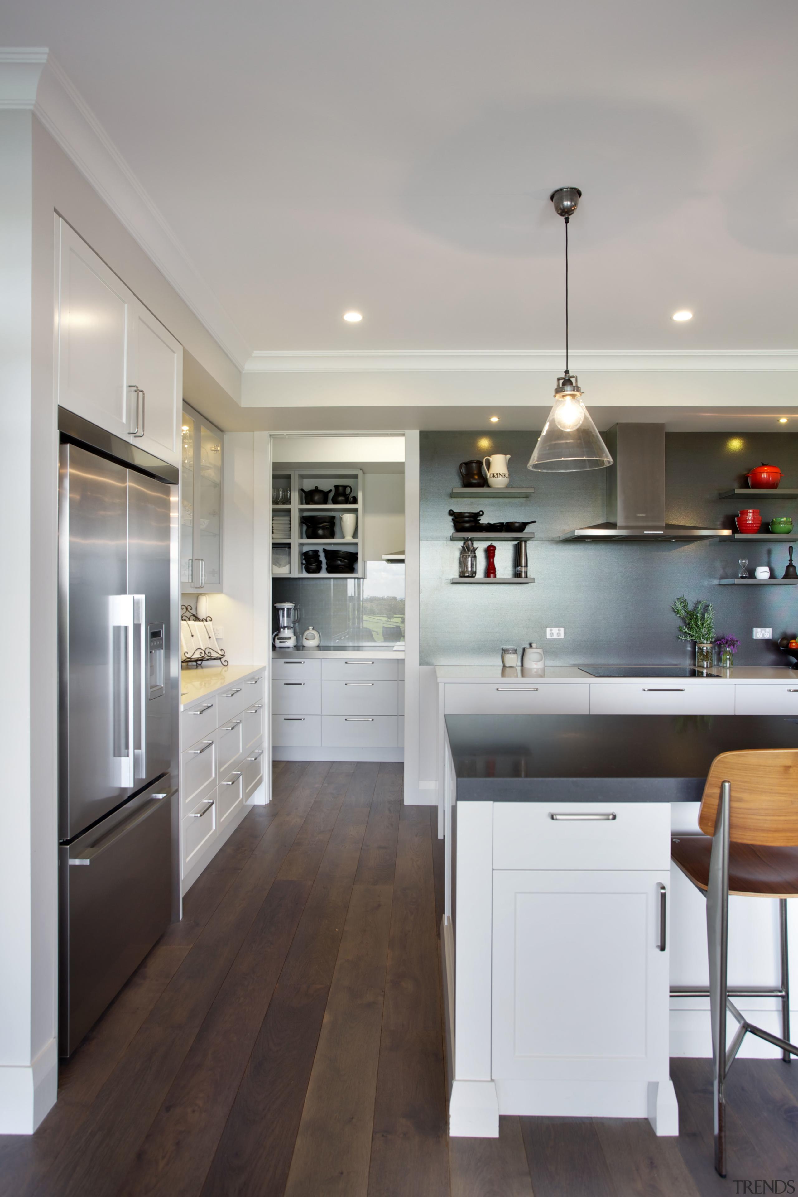 The open door to the scullery shows that cabinetry, countertop, cuisine classique, floor, flooring, home appliance, interior design, kitchen, room, wood flooring, gray
