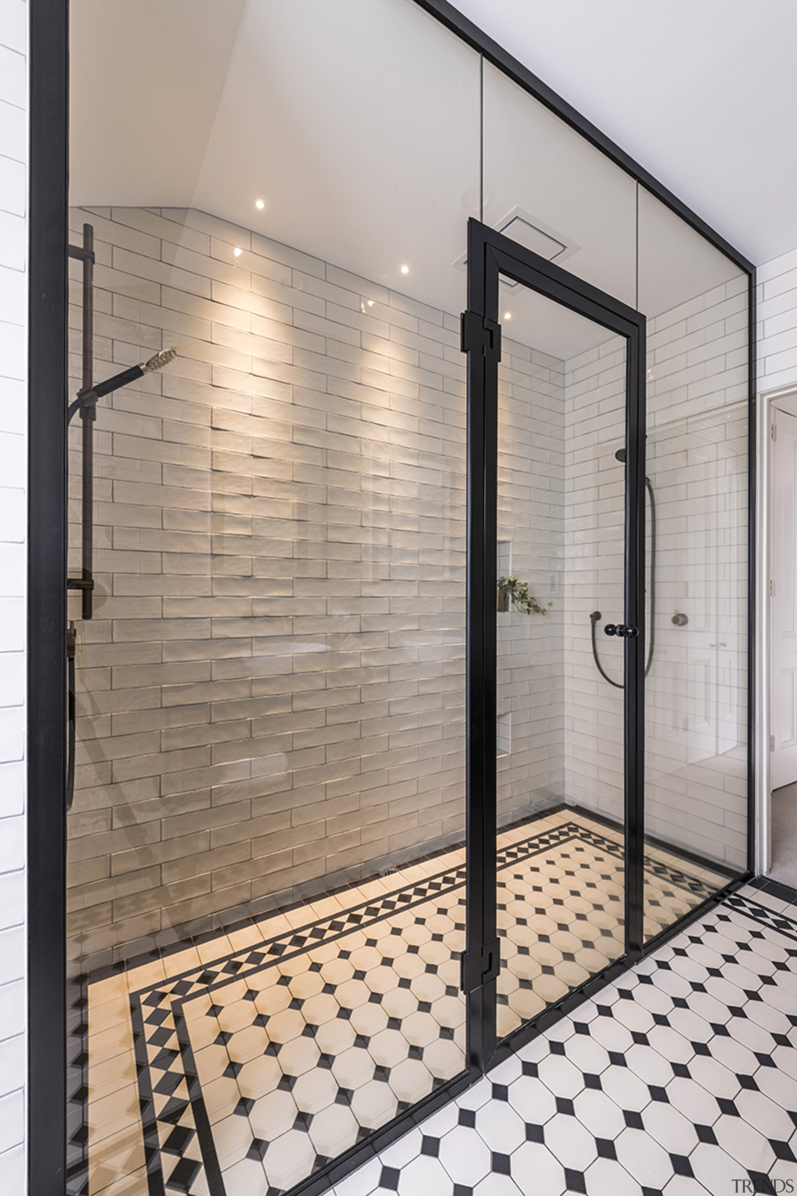 The black metal-framed shower stall is a feature gray