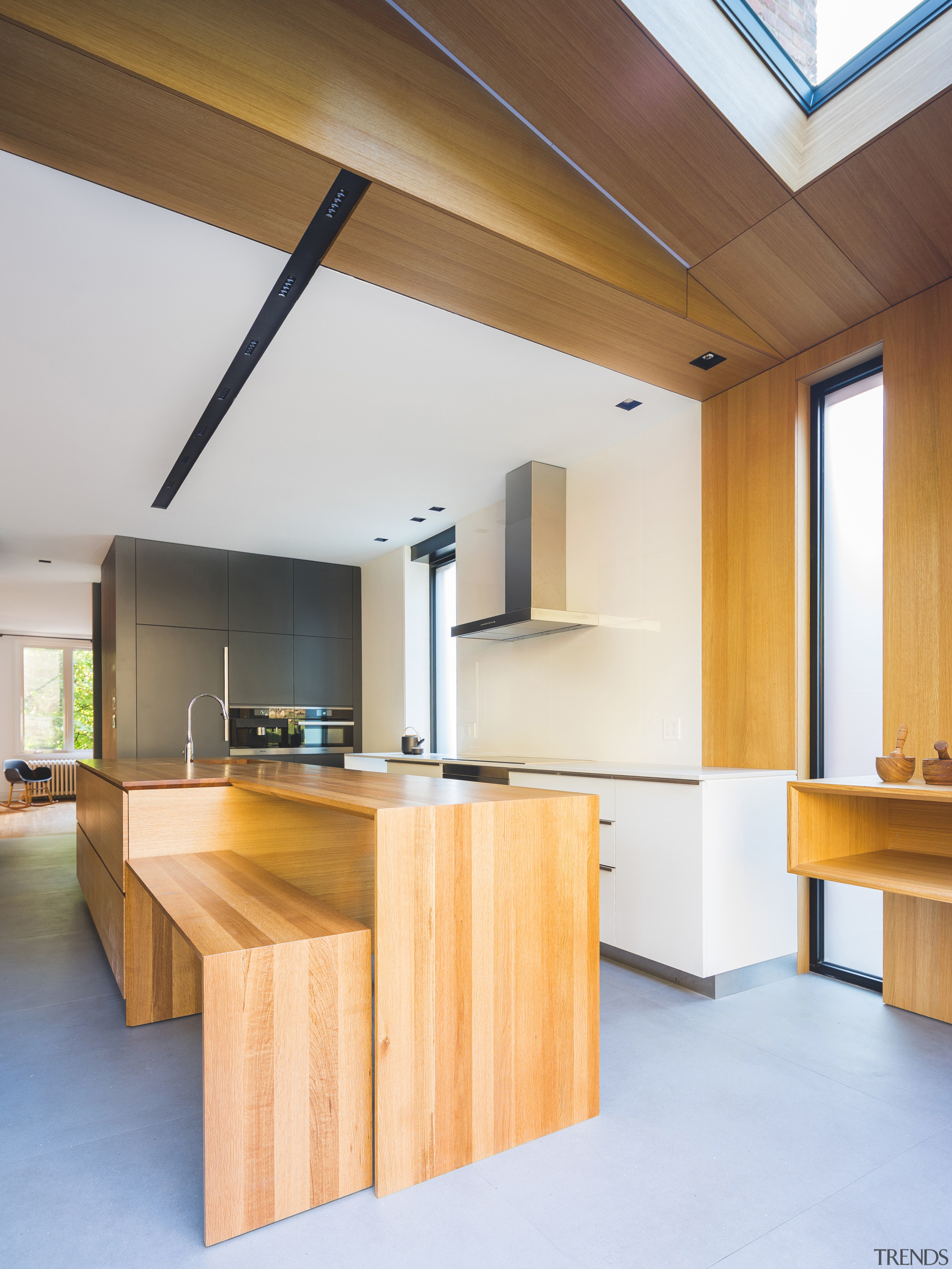 The solid oak island in this kitchen steps architecture, ceiling, floor, furniture, house, interior design, kitchen, product design, table, wood, white