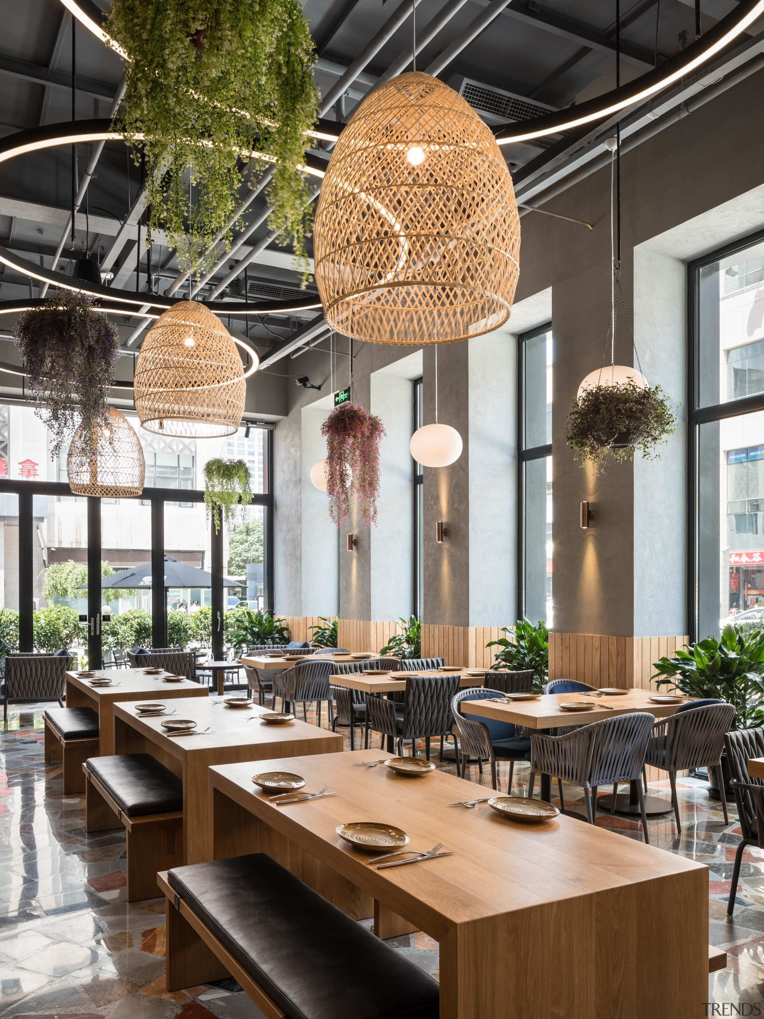 Natural materials, including hanging plants, and natural light architecture, building, ceiling, design, dining room, furniture, home, house, interior design, kitchen & dining room table, light fixture, lighting, lobby, loft, real estate, restaurant, room, table, black