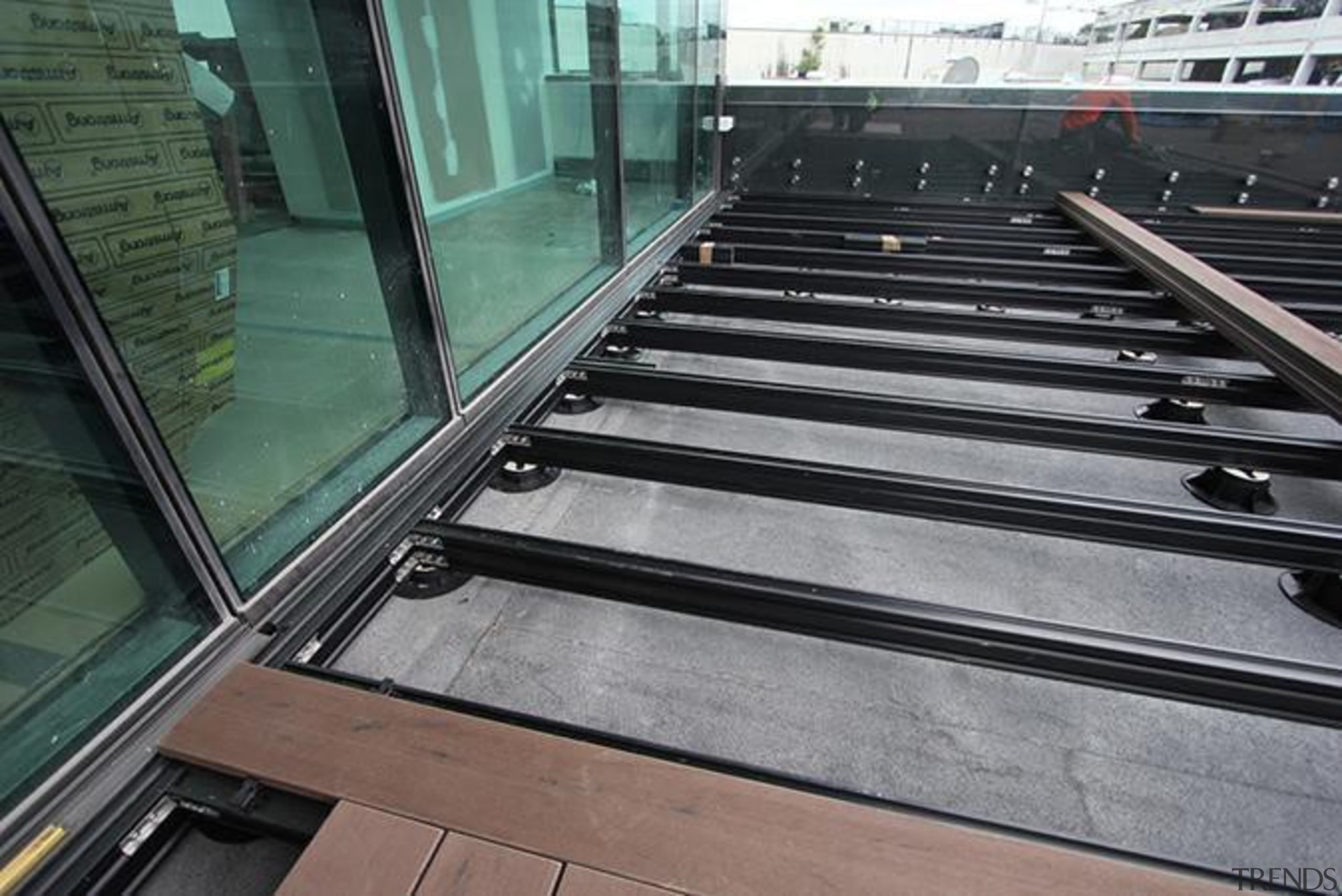 This large beautiful staff decking facility was build architecture, daylighting, floor, glass, line, metal, steel, wood, black, gray