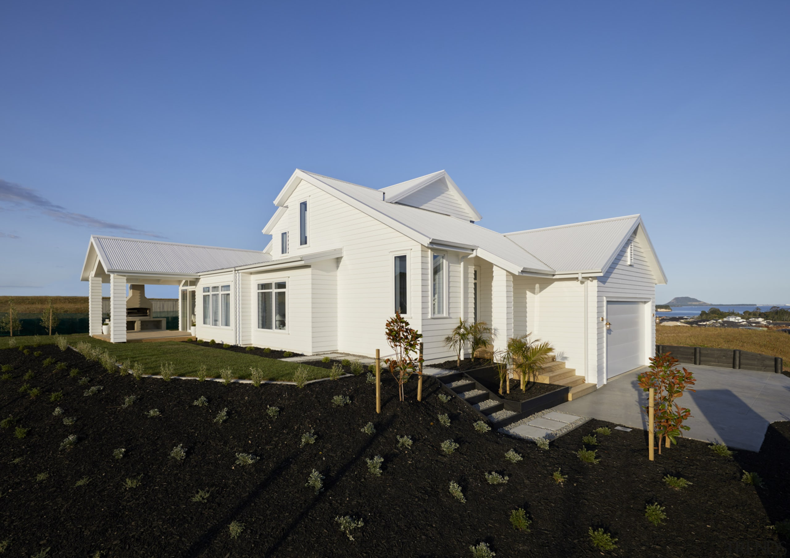 White weatherboard cladding is central to the Landmark
