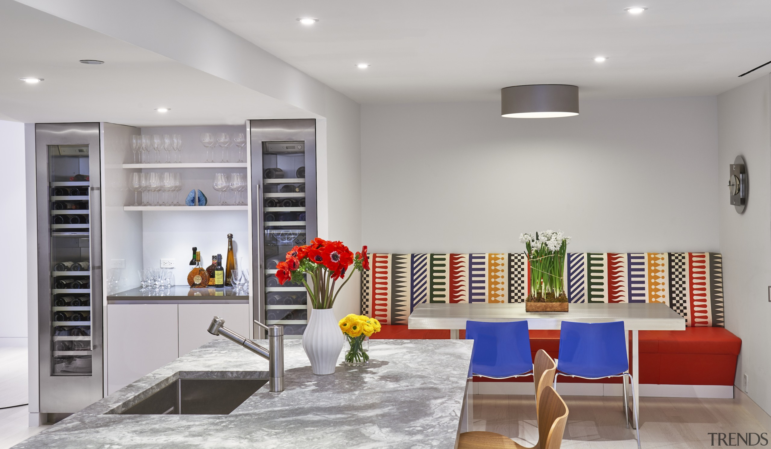 The kitchen also includes a custom banquette upholstered
