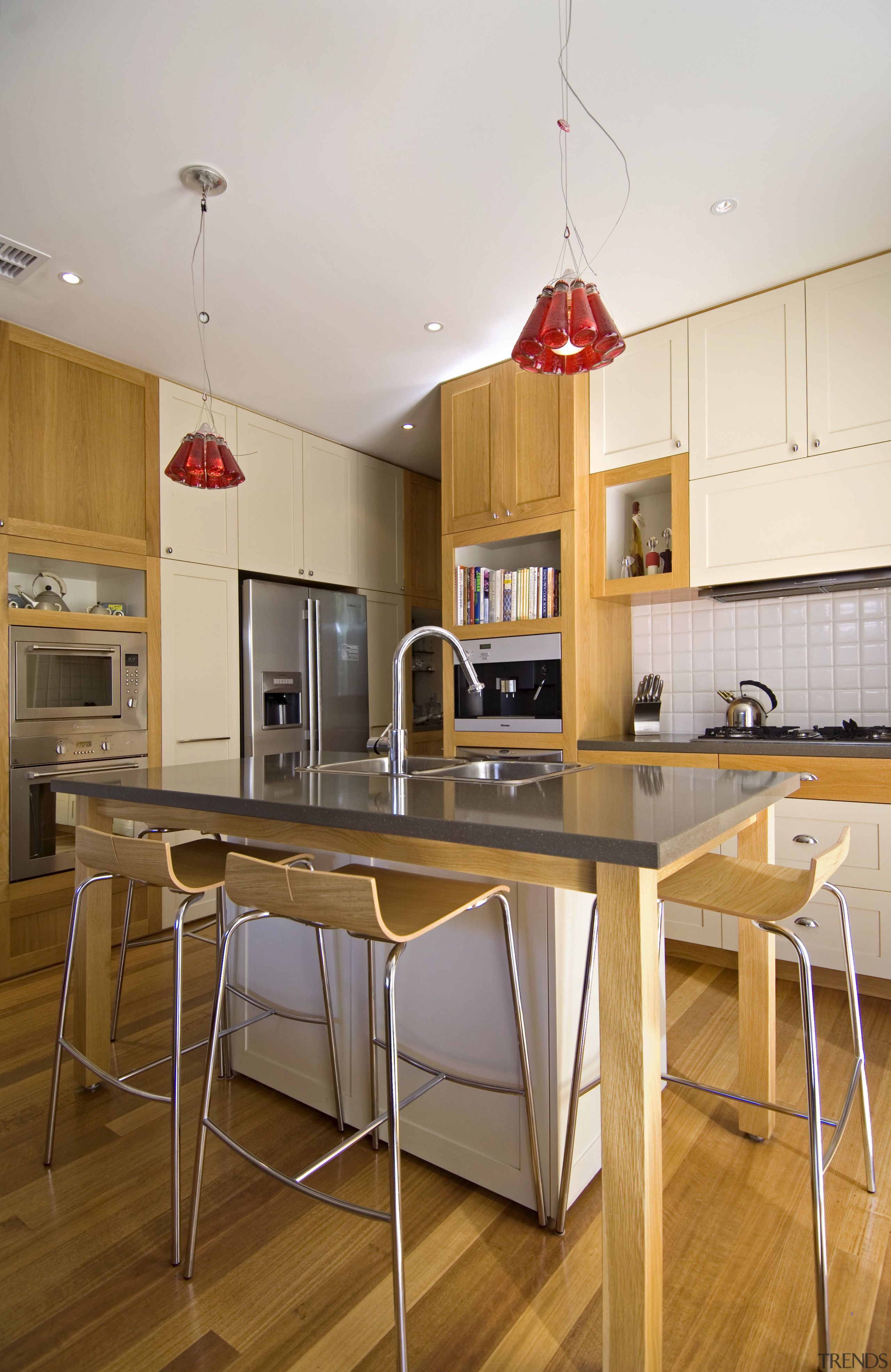View of a renovated kitchen which has had countertop, floor, furniture, interior design, kitchen, real estate, room, table, white, brown