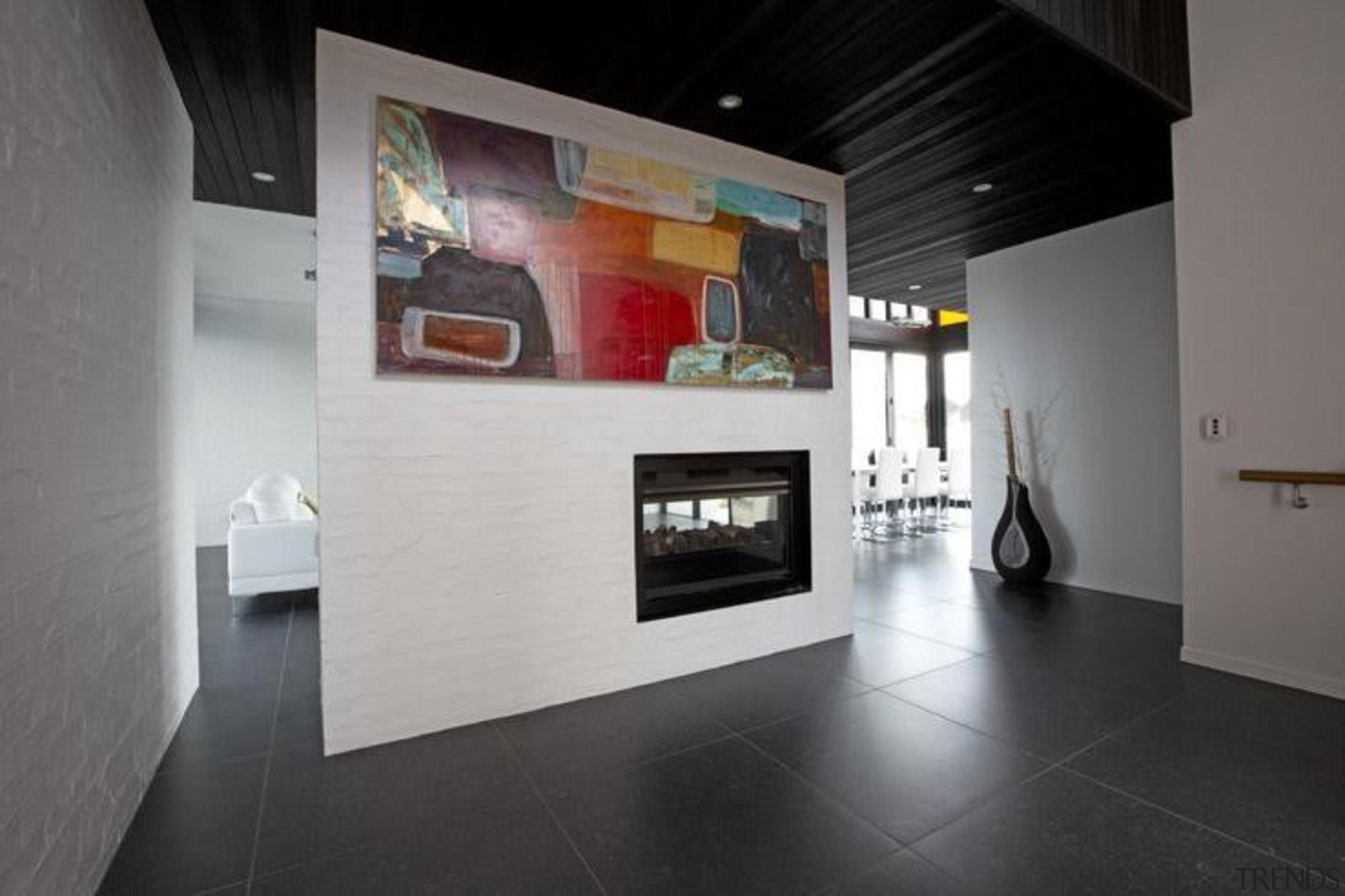 Ivory black hallway area. - Blue Mountain Range exhibition, floor, flooring, hearth, interior design, property, gray, black