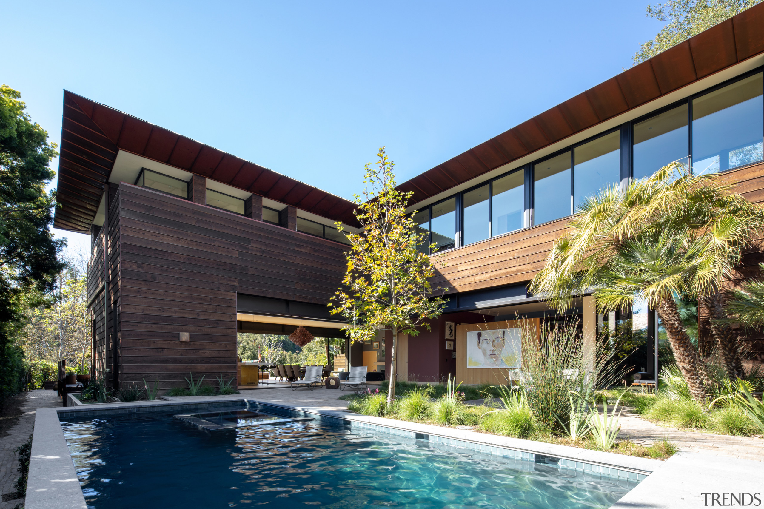 The pool features a Heath Ceramics tile border