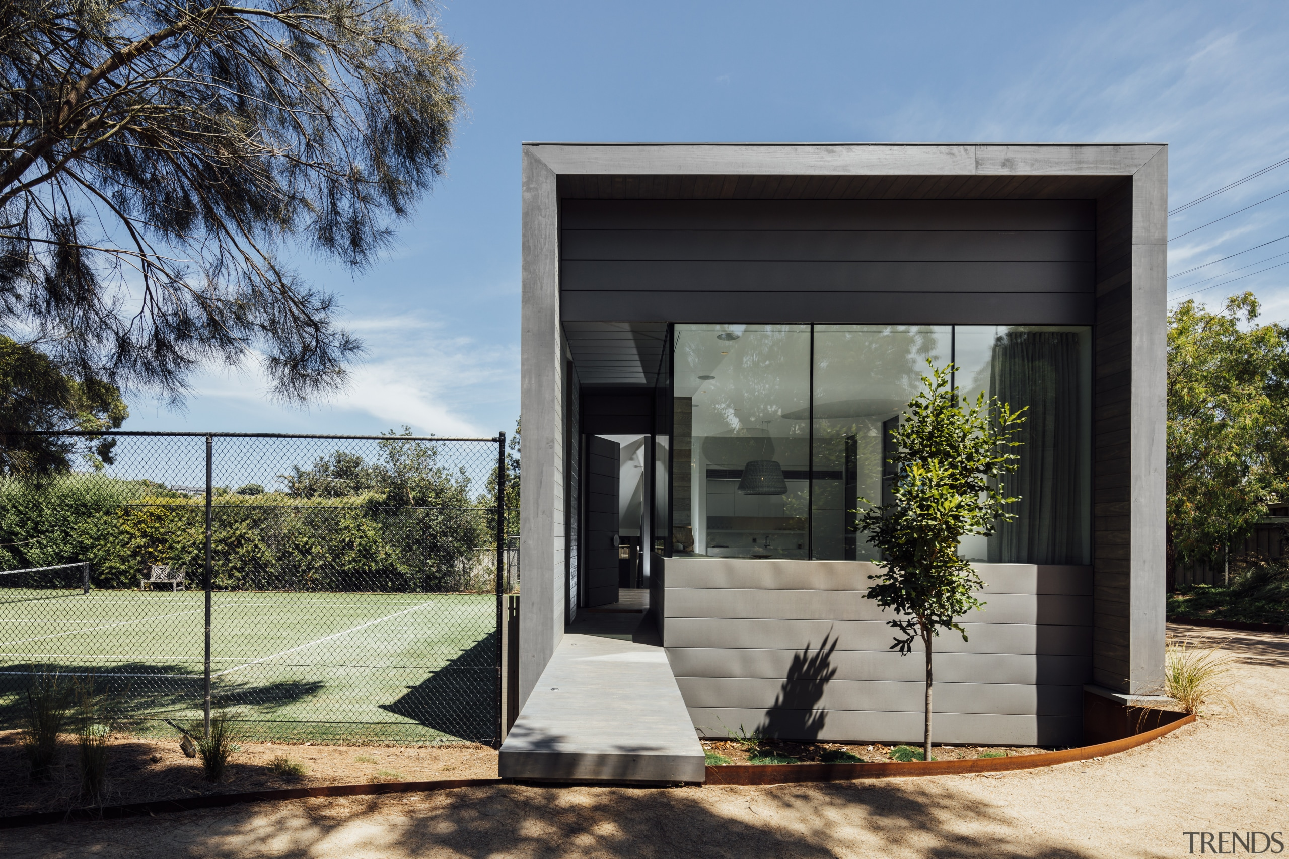 A small ramp leads up to this homes architecture, building, facade, home, house, real estate, black