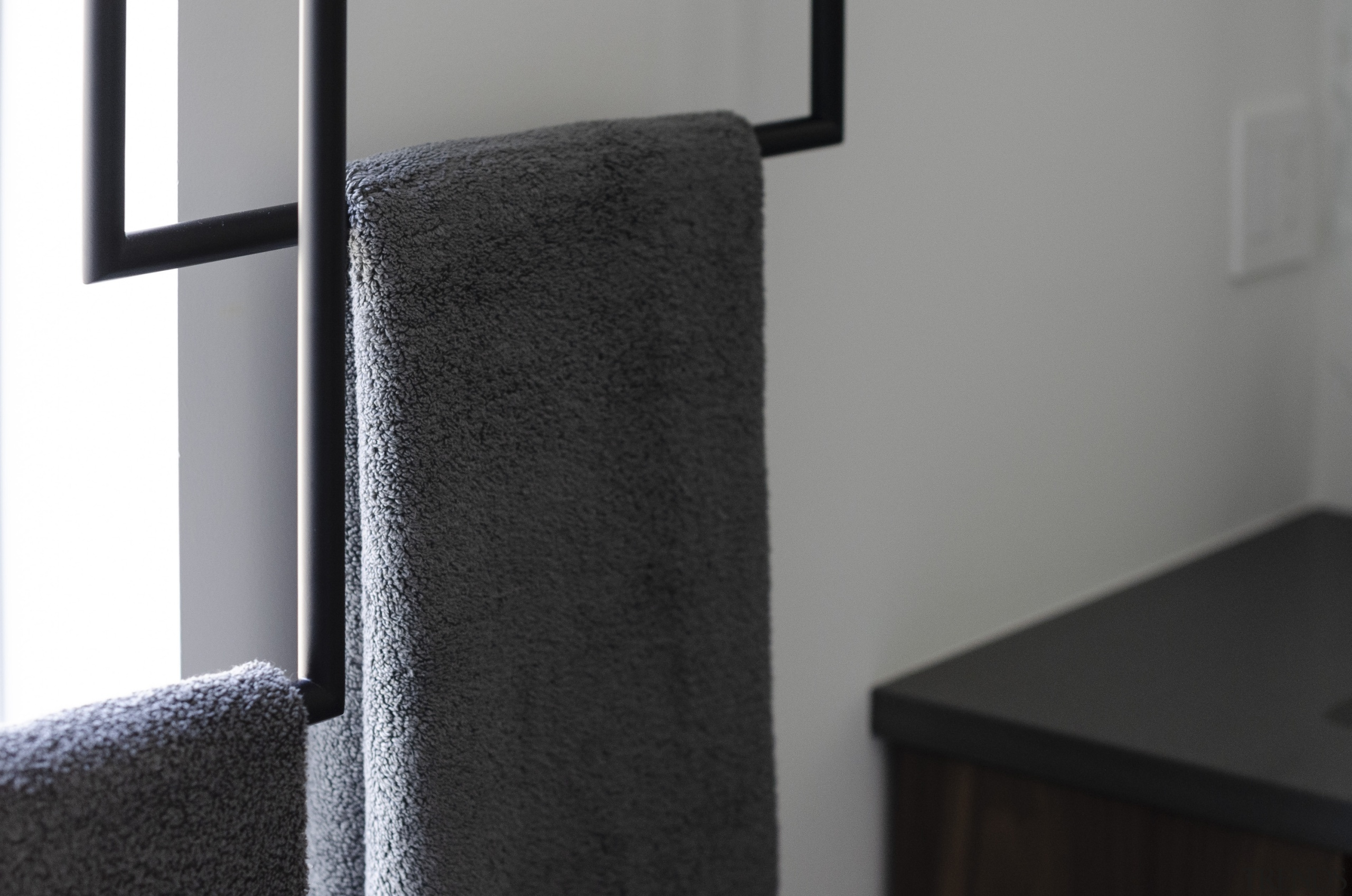 The ceiling mounted towel bars were custom designed