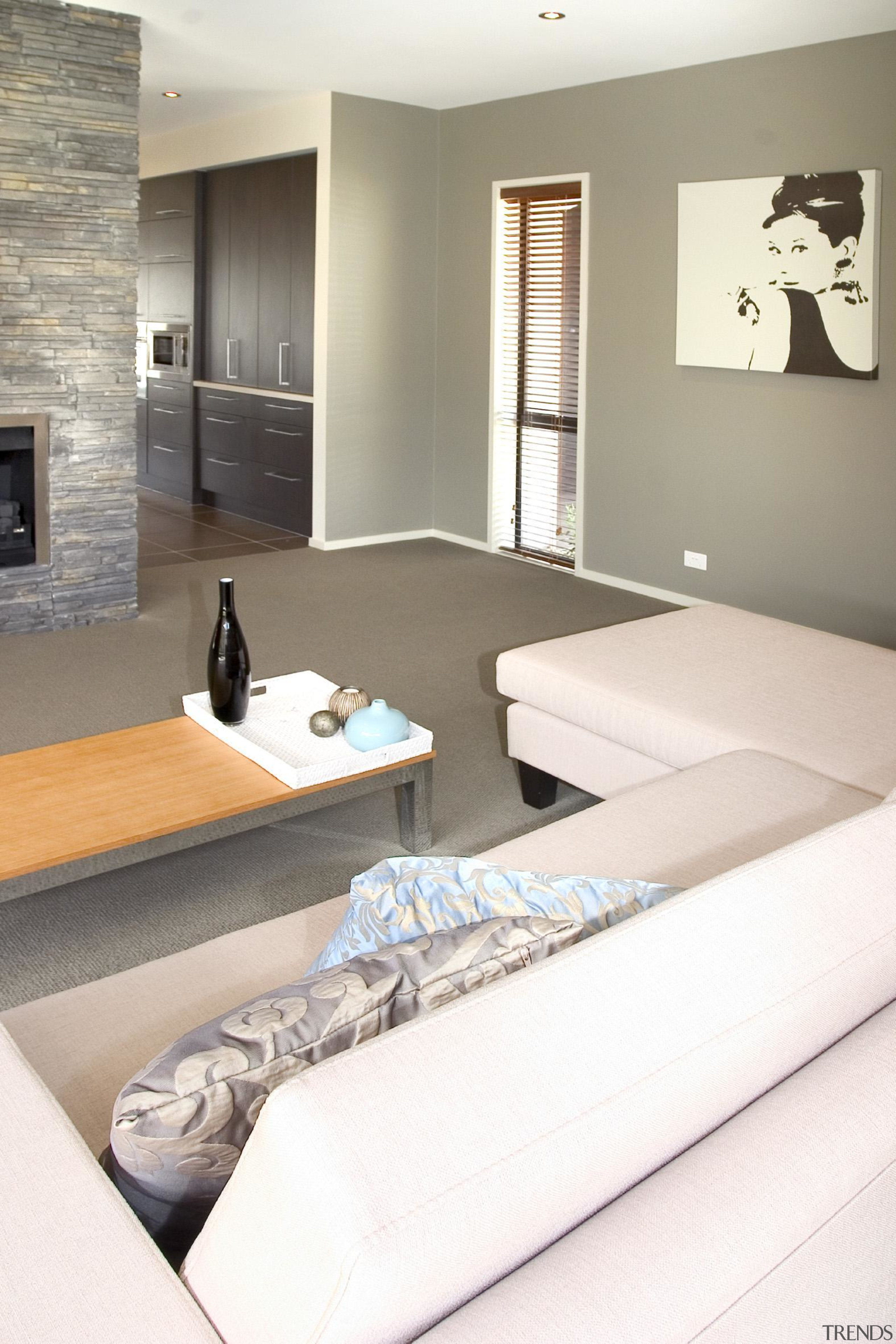 Sand colored lounge for families in Karaka - architecture, floor, flooring, furniture, home, interior design, living room, room, table, wall, white, gray