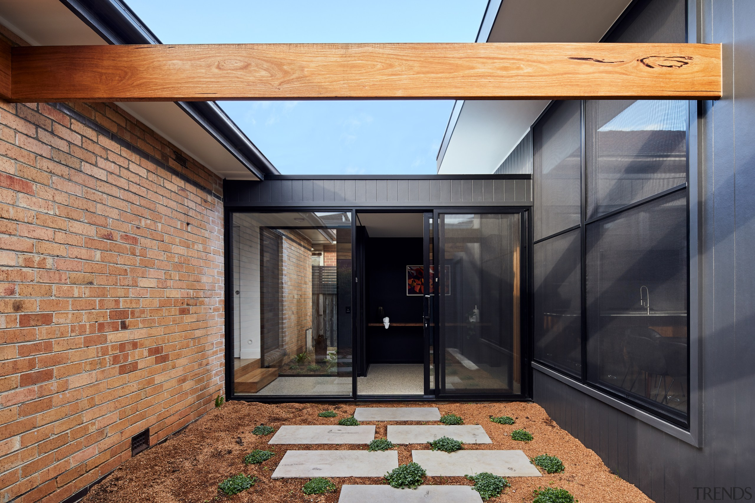 A glass door in a glass wall accesses