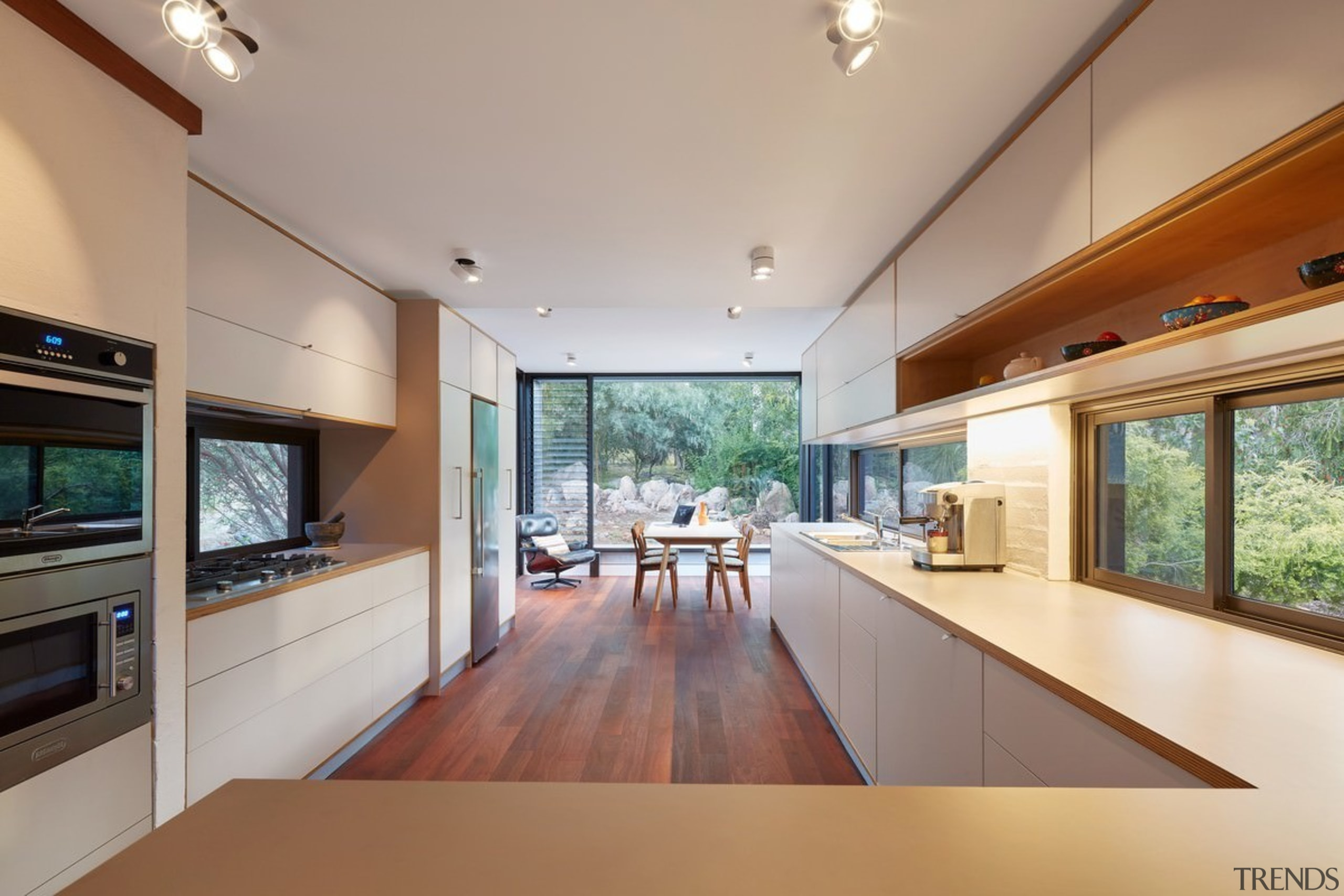 The home features clean sight lines - The architecture, ceiling, countertop, daylighting, estate, hardwood, home, house, interior design, kitchen, living room, property, real estate, window, gray