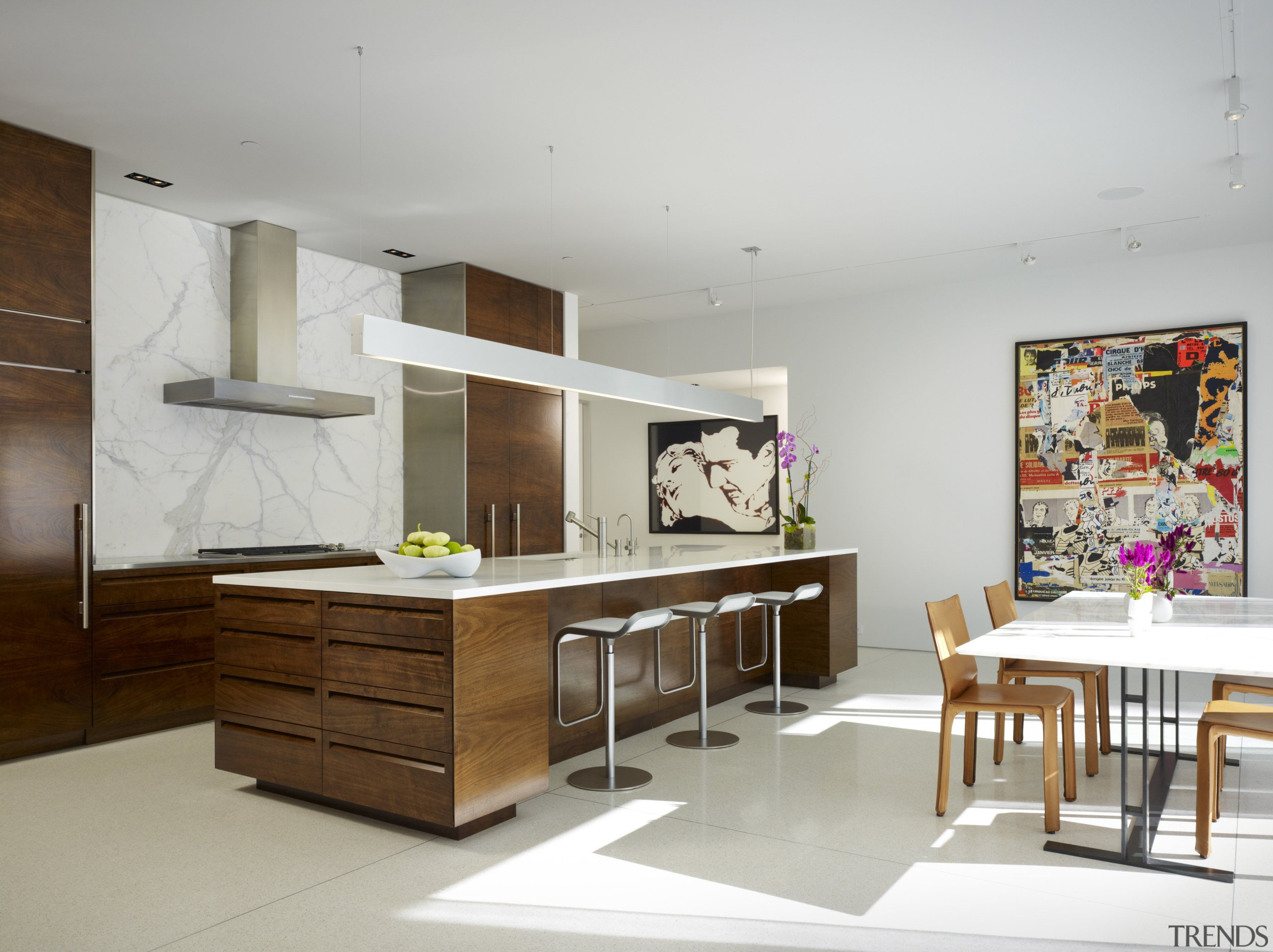 The artwork in the kitchen is by Jacques furniture, interior design, kitchen, product design, table, gray