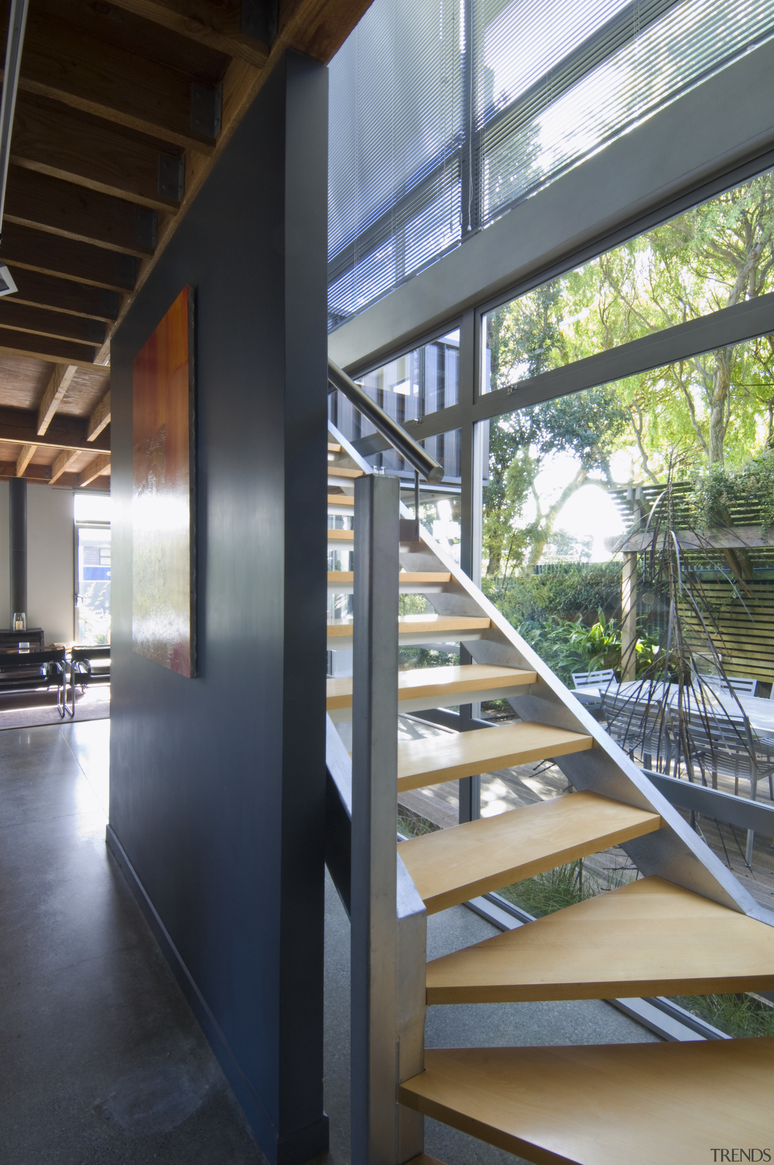 View of stairway with steel railing and timber architecture, daylighting, glass, handrail, stairs, structure, black, gray