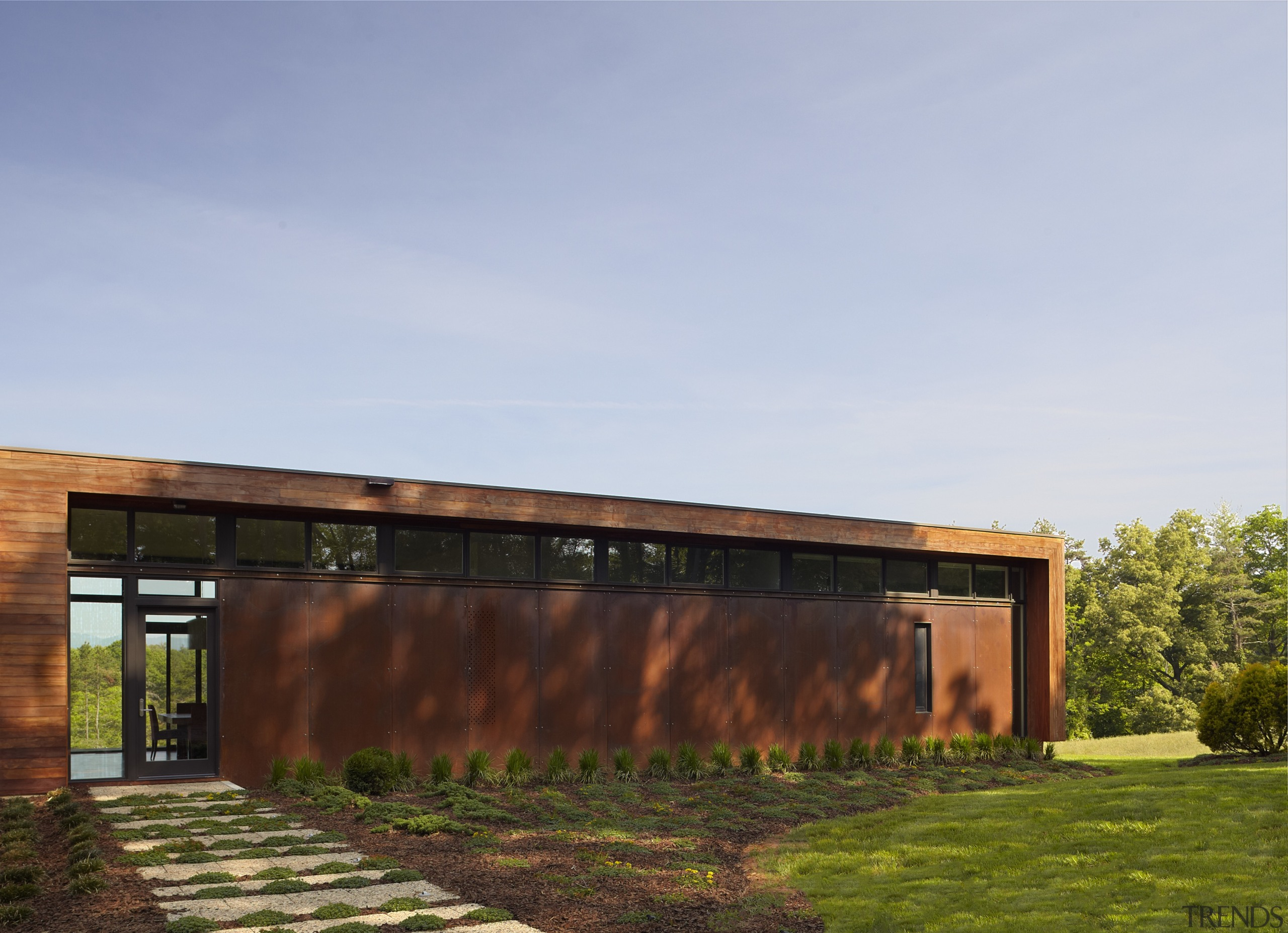 Exterior of house with rusted corten steel. Sustainable architecture, estate, facade, home, house, real estate, residential area, shed, sky, teal
