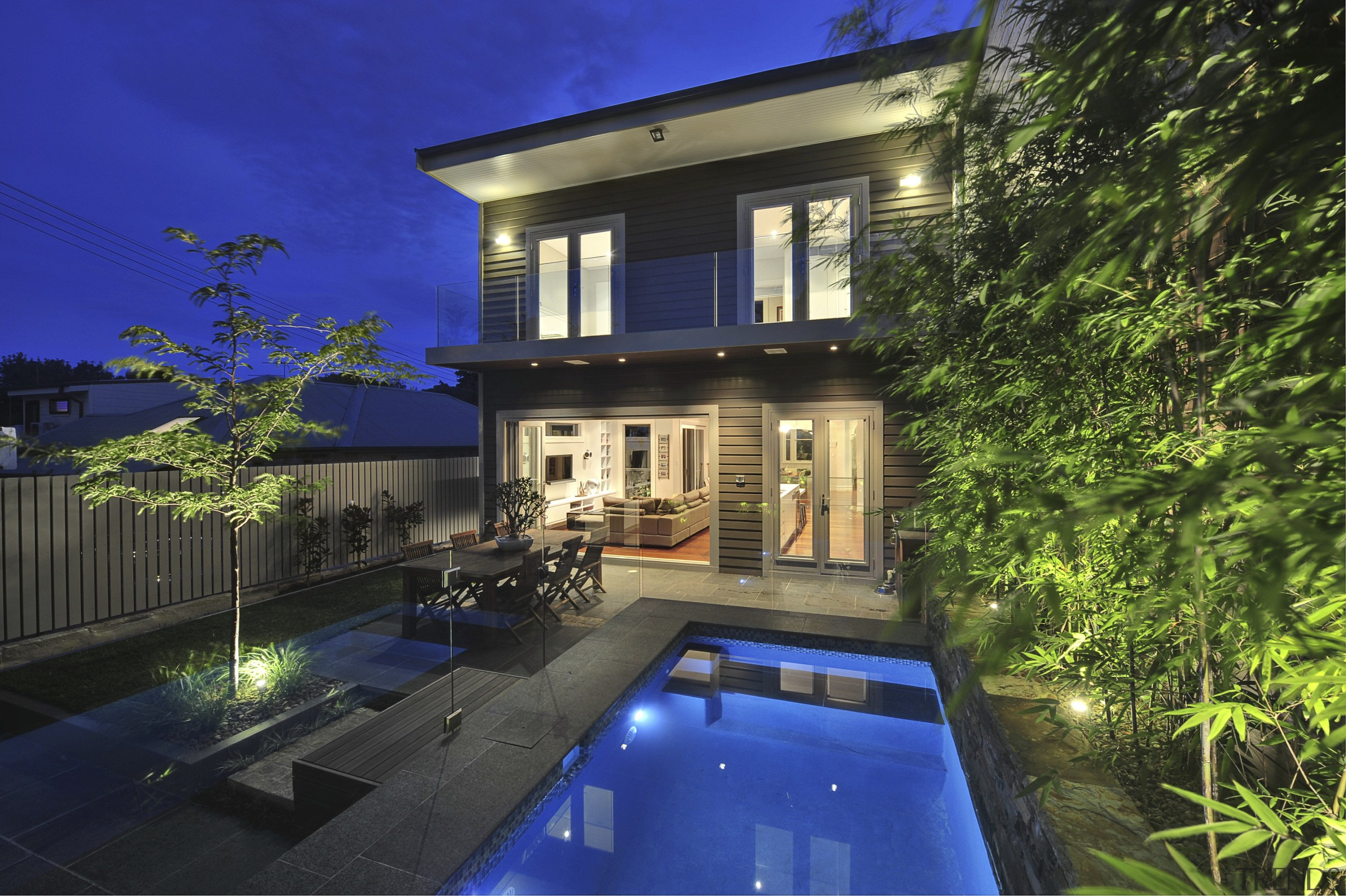 Backside of house with pool. - Backside of apartment, architecture, backyard, cottage, courtyard, estate, facade, family car, home, house, landscape lighting, lighting, mansion, property, real estate, reflection, residential area, sky, swimming pool, villa, window, blue