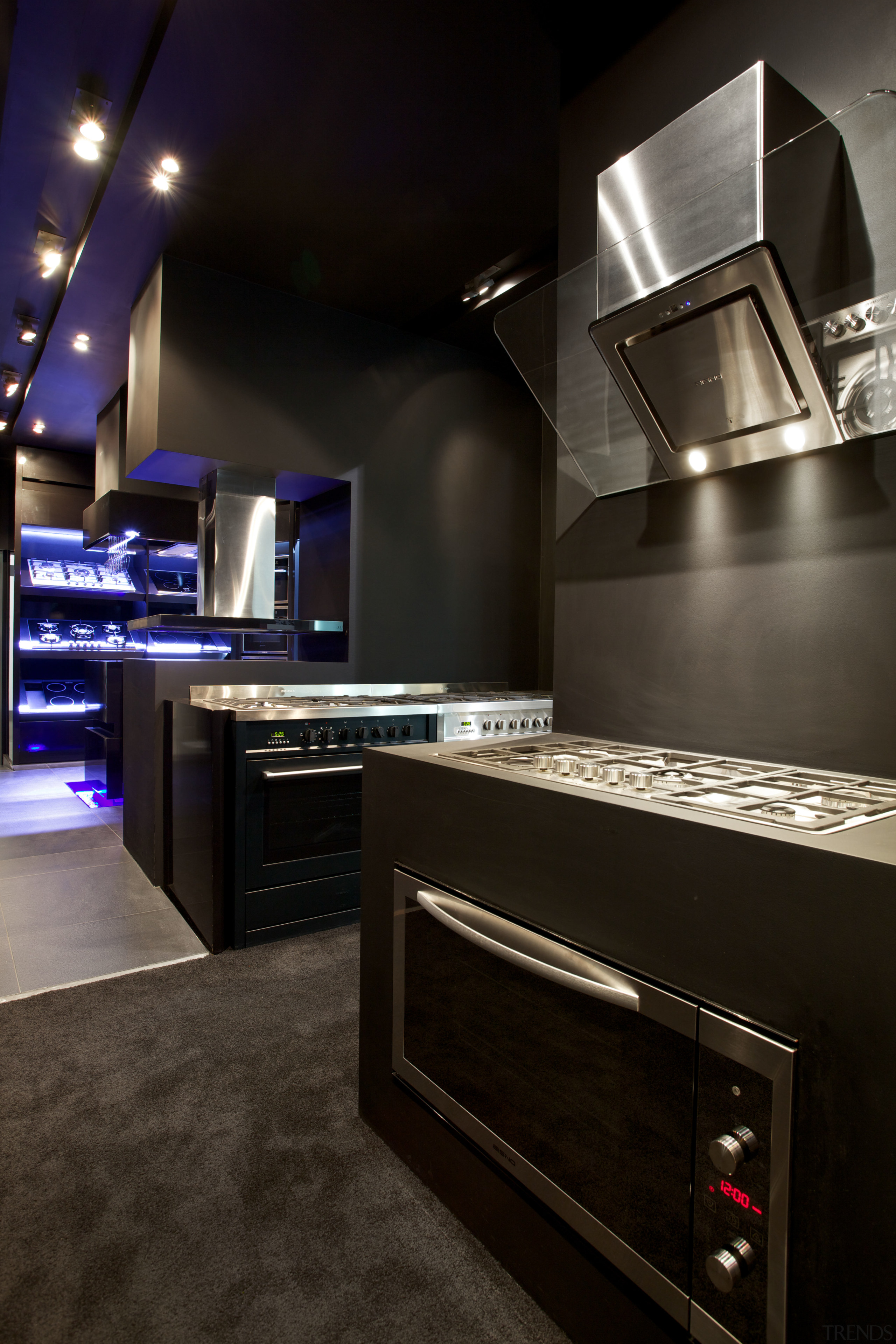 At the Eisno showroom, you can compare different countertop, interior design, kitchen, lighting, room, black