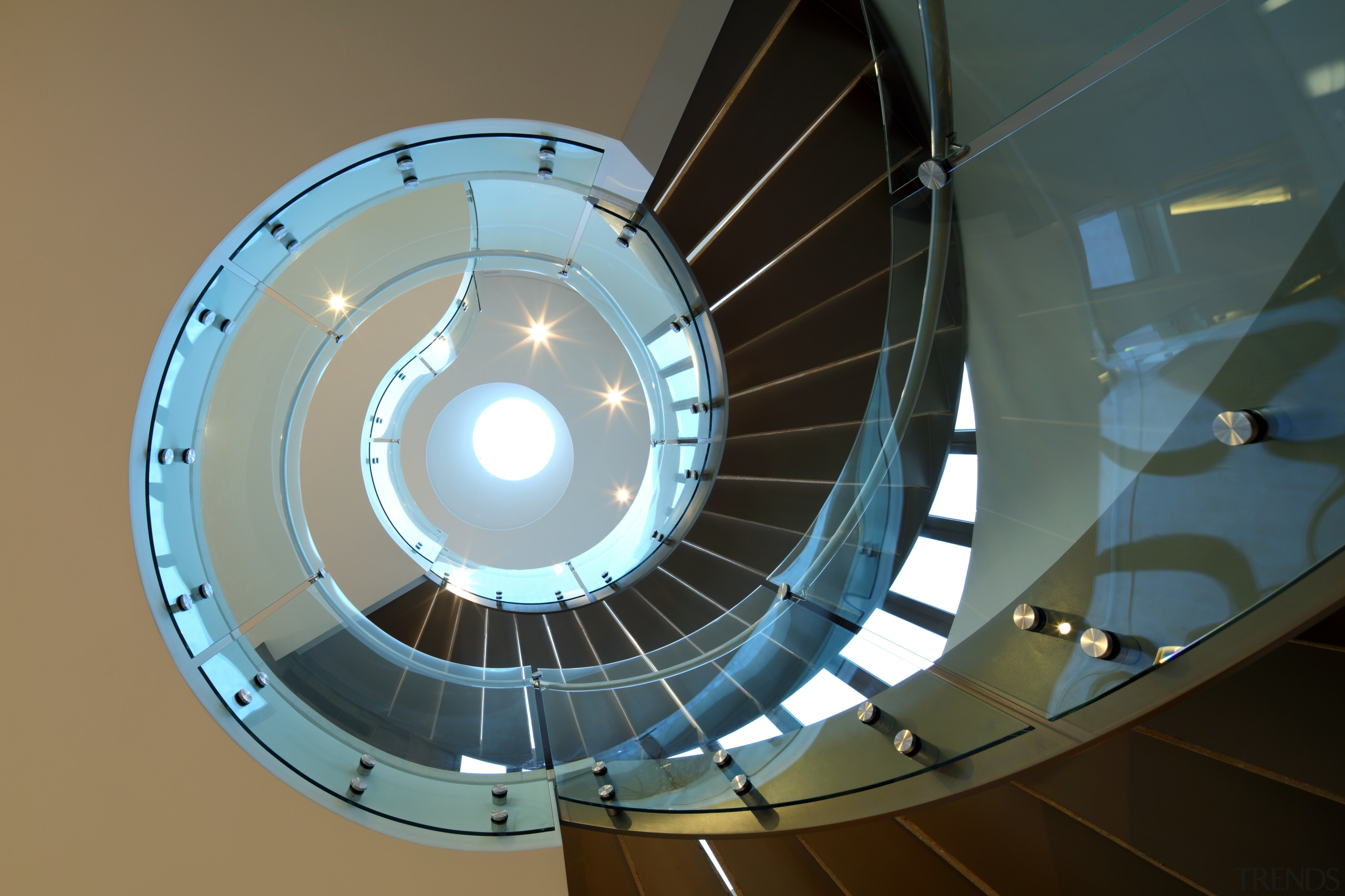 This circulation stair connects all three levels of architecture, ceiling, circle, daylighting, light, lighting, product design, spiral, black, brown