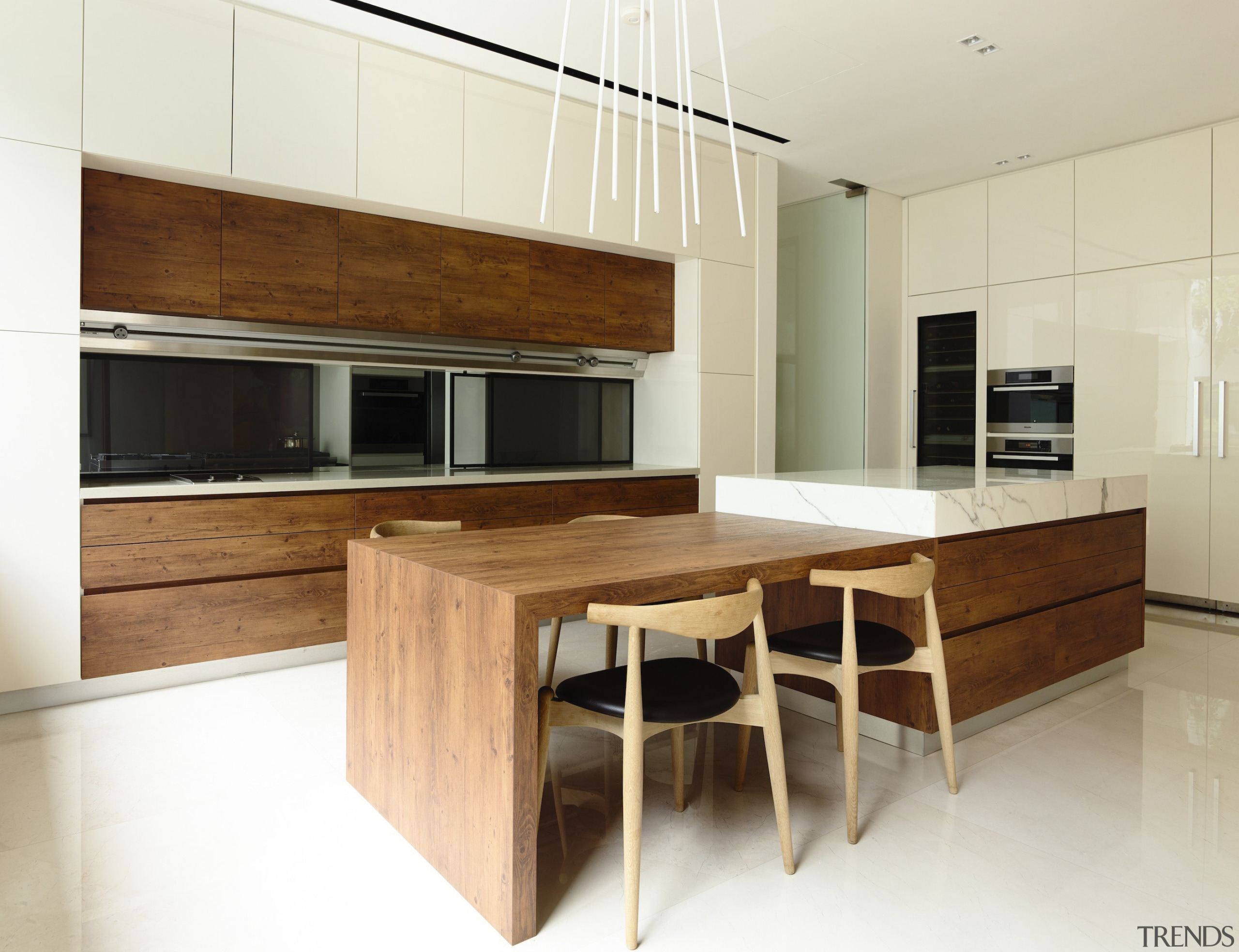 Stained pine wood cabinets make a bold textural cabinetry, countertop, cuisine classique, floor, flooring, furniture, hardwood, interior design, kitchen, real estate, table, wood, wood flooring, white