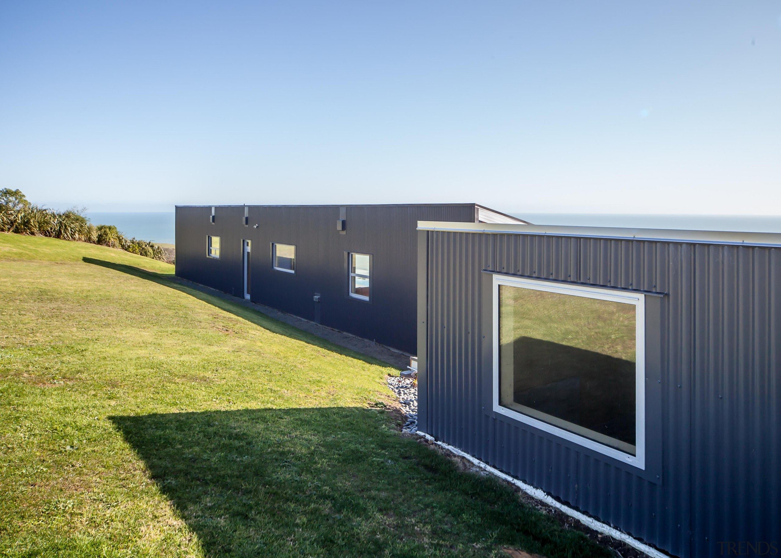 Capturing the spectacular views was a priority for architecture, facade, grass, home, house, property, real estate, shed, siding, sky, white