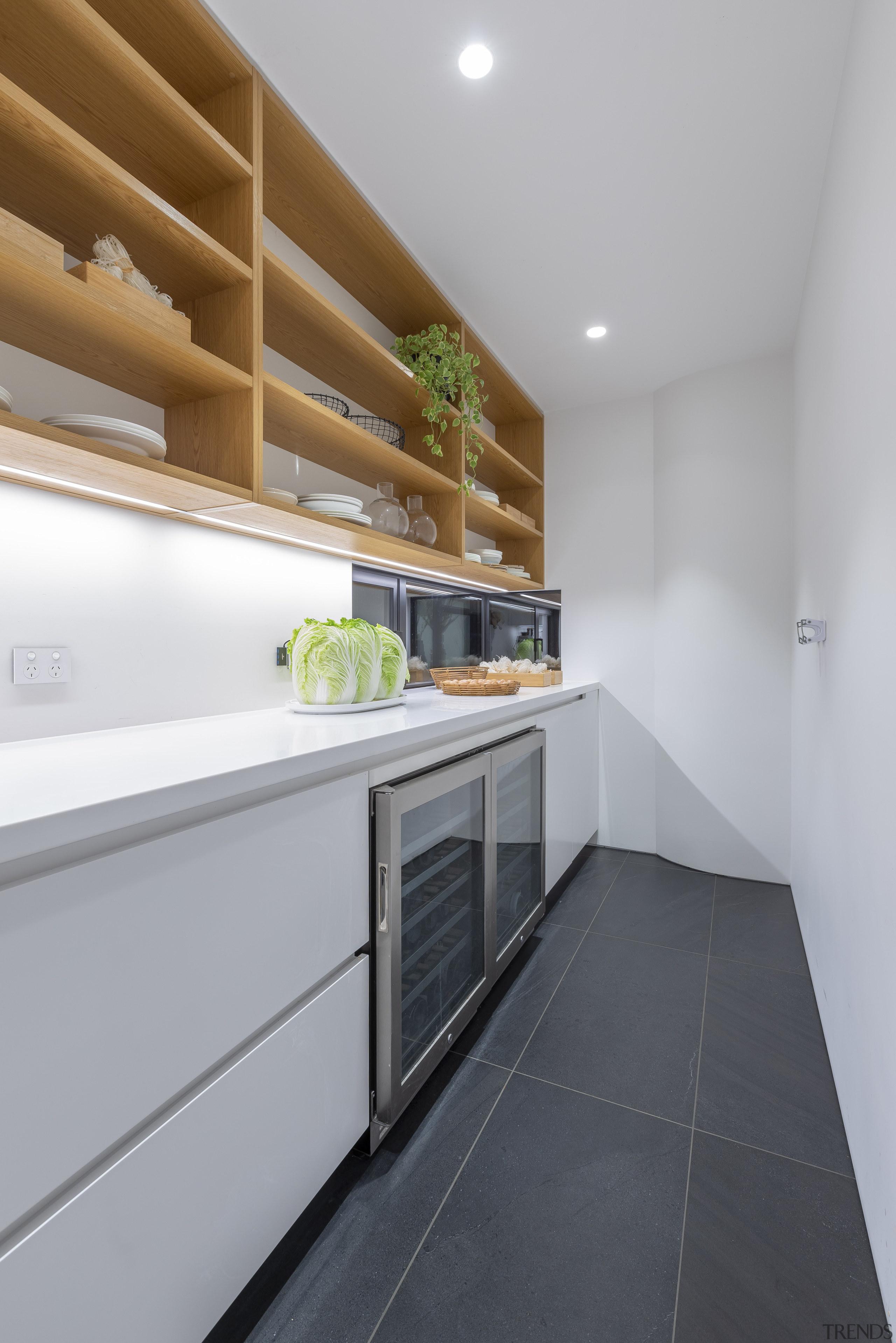 Black floor tiles seen in the living spaces