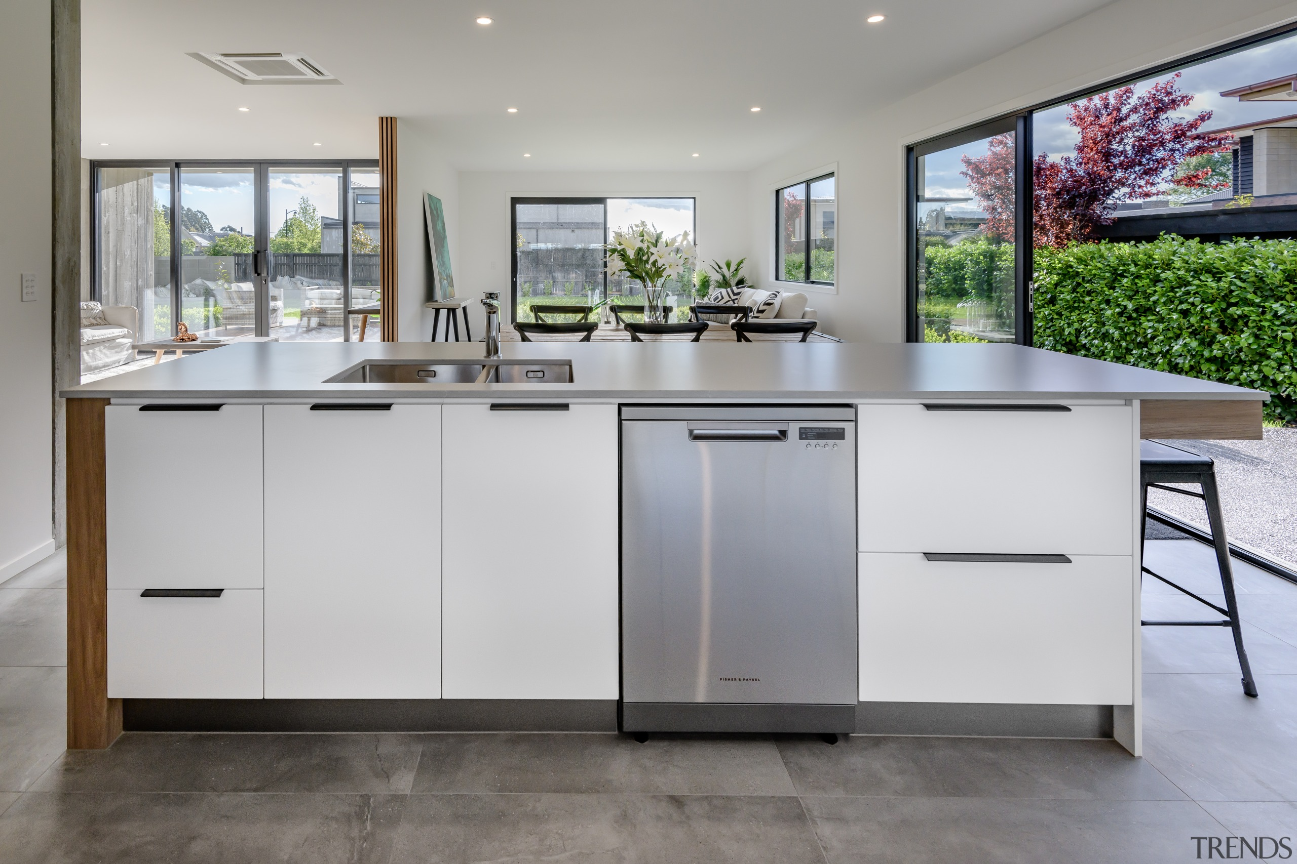 This kitchen island includes deep drawers with cutlery