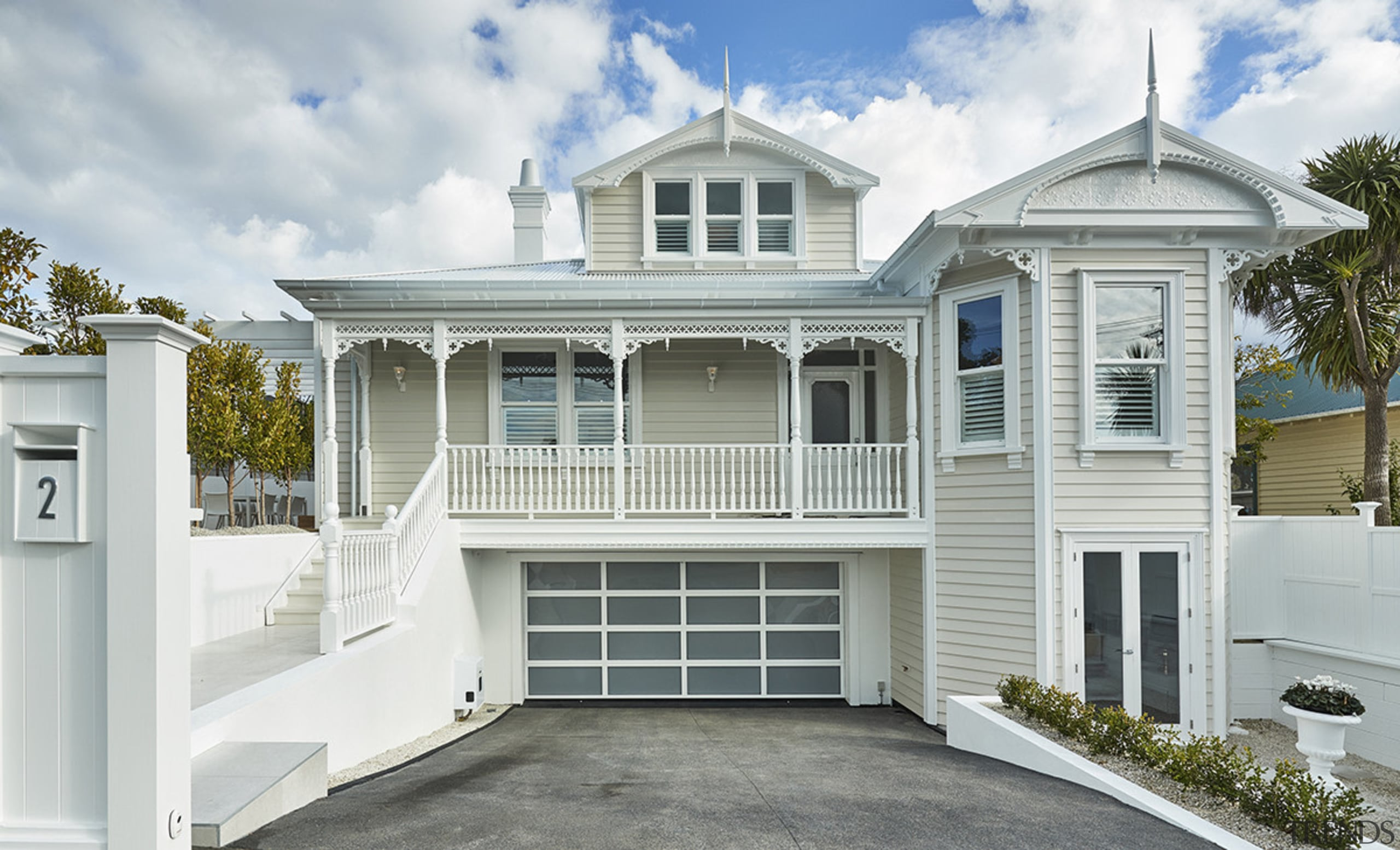 This comprehensive villa renovation was almost a new building, elevation, estate, facade, home, house, property, real estate, residential area, siding, window, gray, white