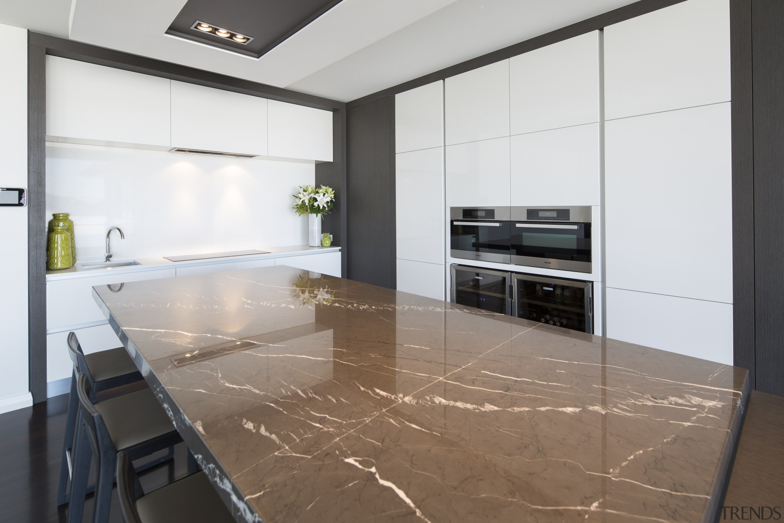 Contemporary kitchen with marble benchtop - Contemporary kitchen countertop, floor, flooring, interior design, kitchen, property, real estate, tile, white