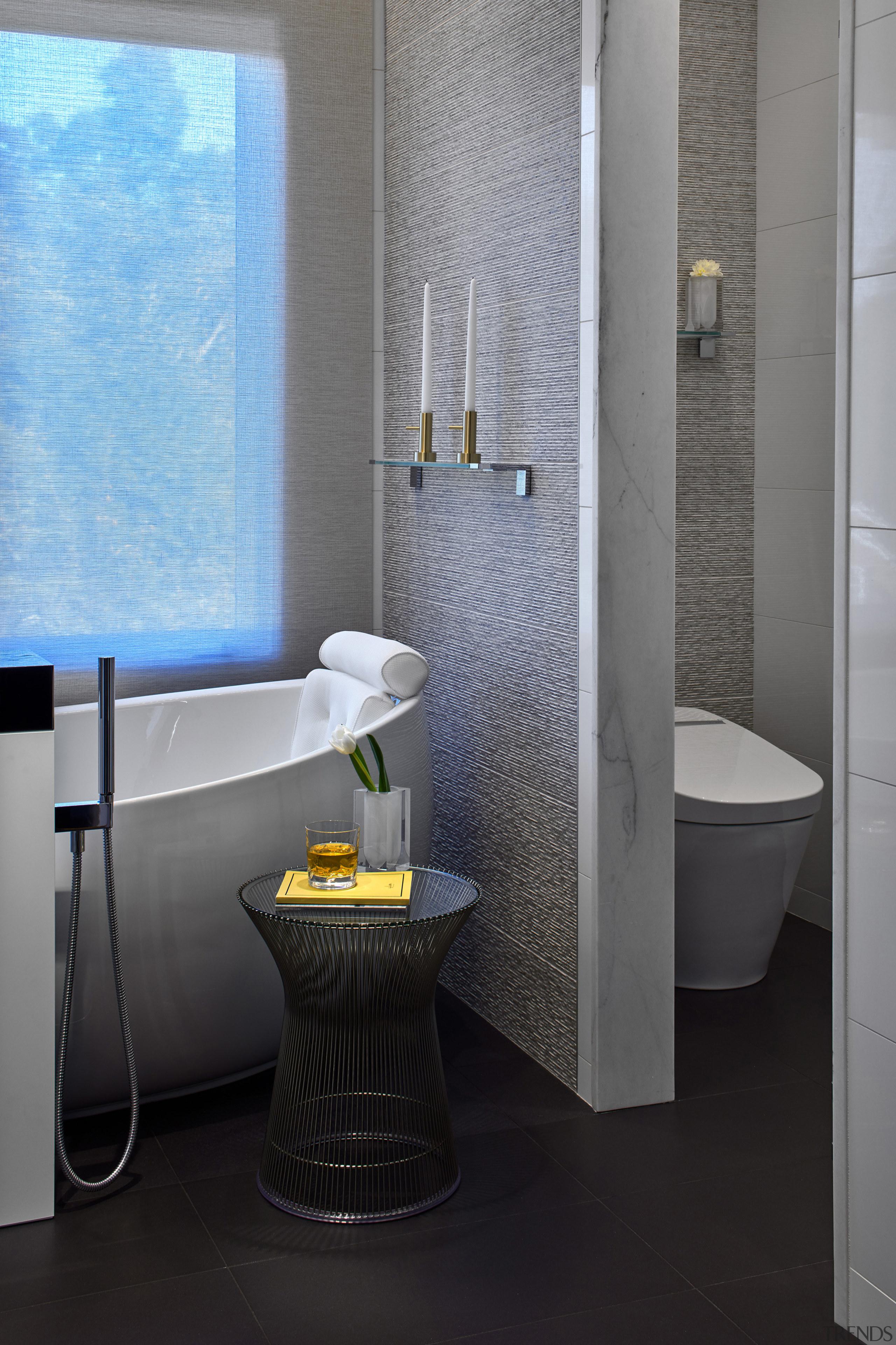 Textured wall tile meets marble door jamb on bathroom, bidet, ceramic, floor, interior design, plumbing fixture, room, tap, tile, toilet, toilet seat, gray, black