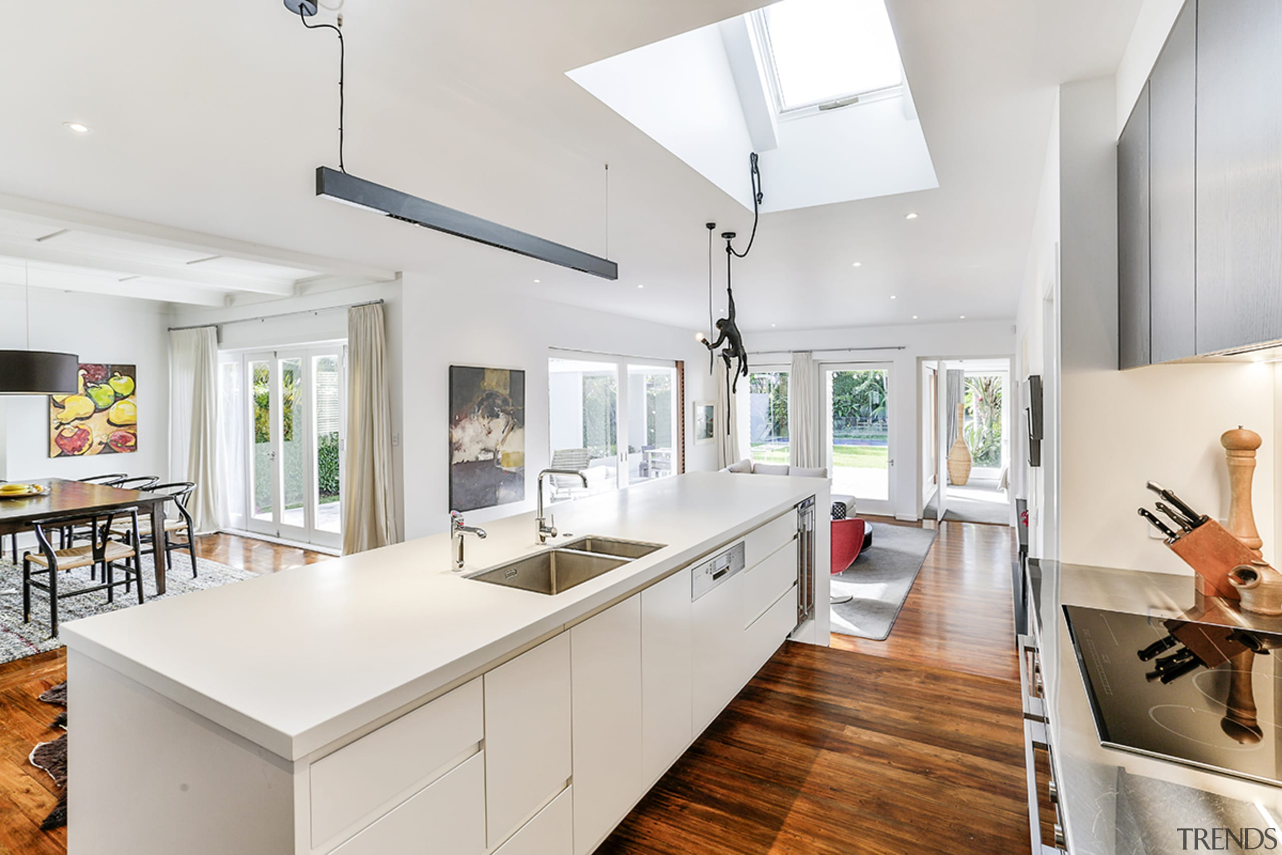 Wood floors contrast white cabinetry in this spacious architecture, building, cabinetry, ceiling, countertop, daylighting, floor, flooring, furniture, hardwood, home, house, interior design, kitchen, property, real estate, room, table, wood flooring, yellow, white