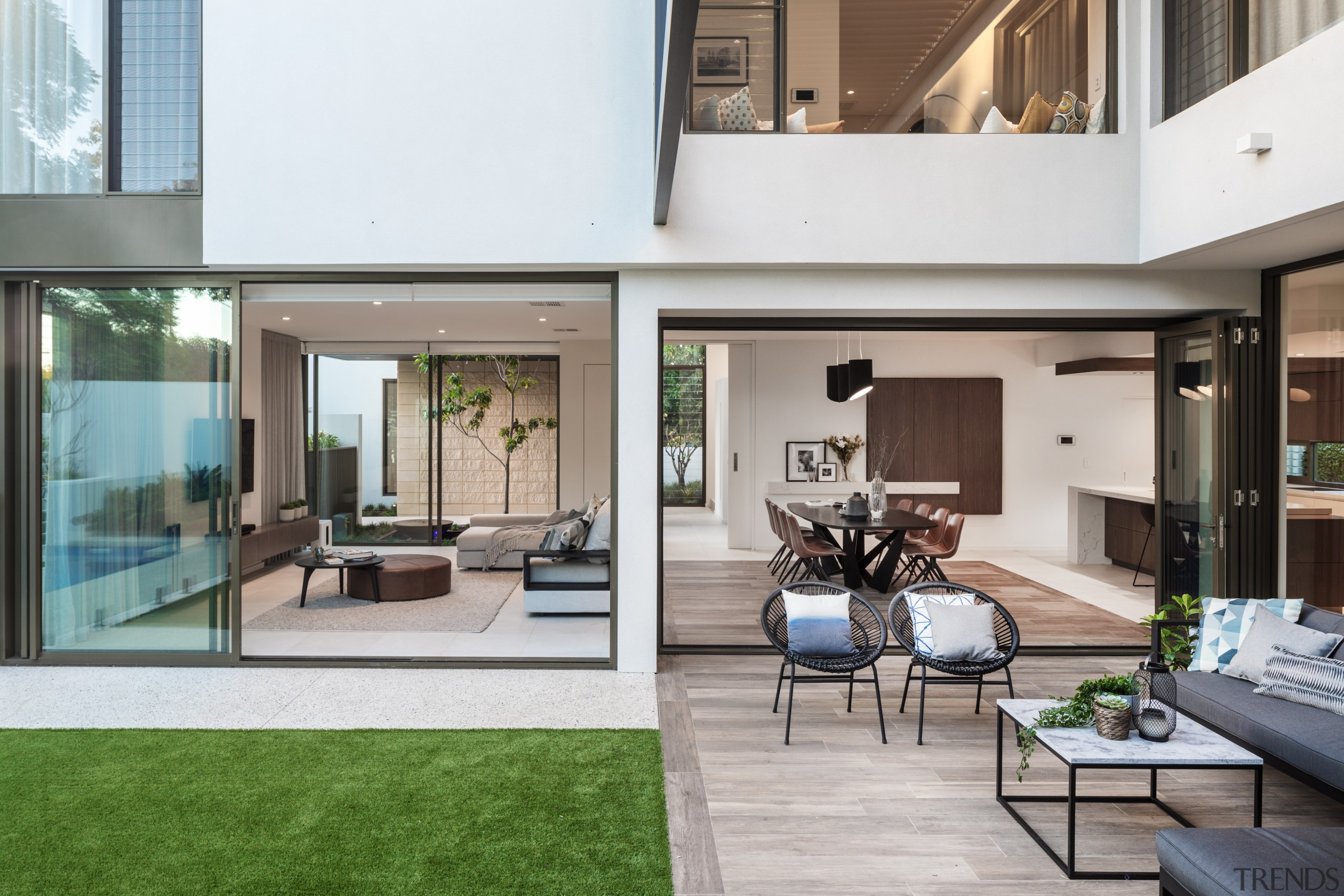 Open sesame – seen here from the back apartment, architecture, backyard, building, ceiling, condominium, design, estate, facade, floor, flooring, furniture, home, house, interior design, living room, property, real estate, residential area, room, table, window, gray