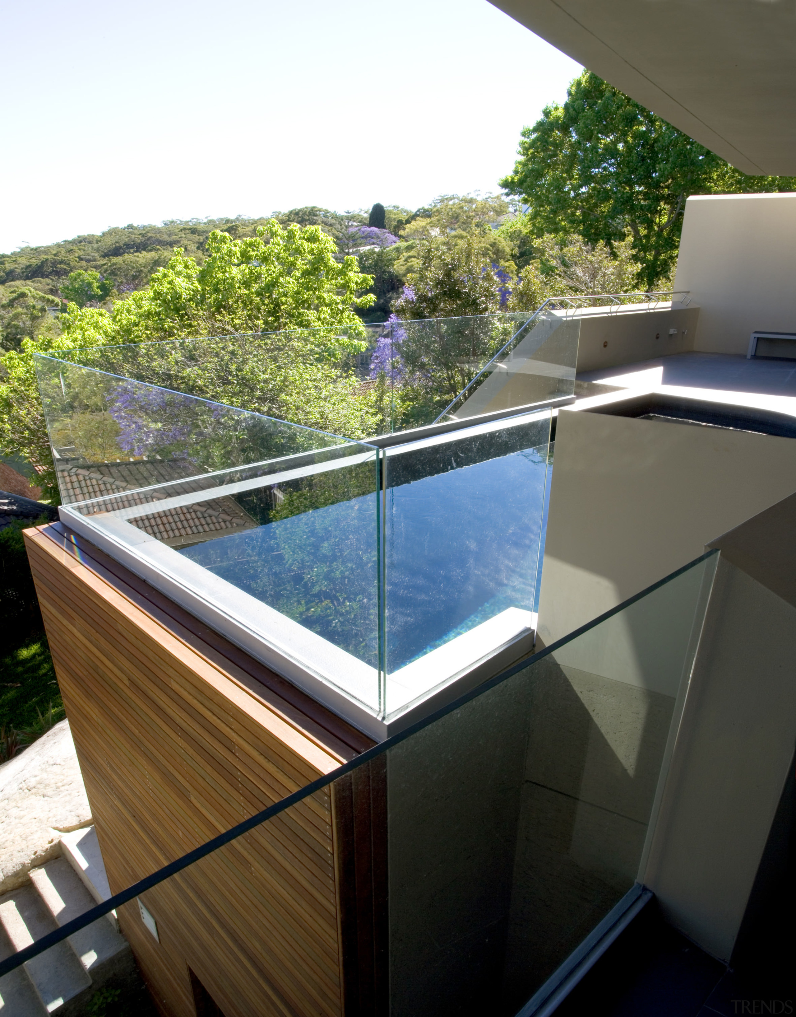An existing staircase runs down to the garden architecture, daylighting, glass, house, property, real estate, reflection, roof, swimming pool, water