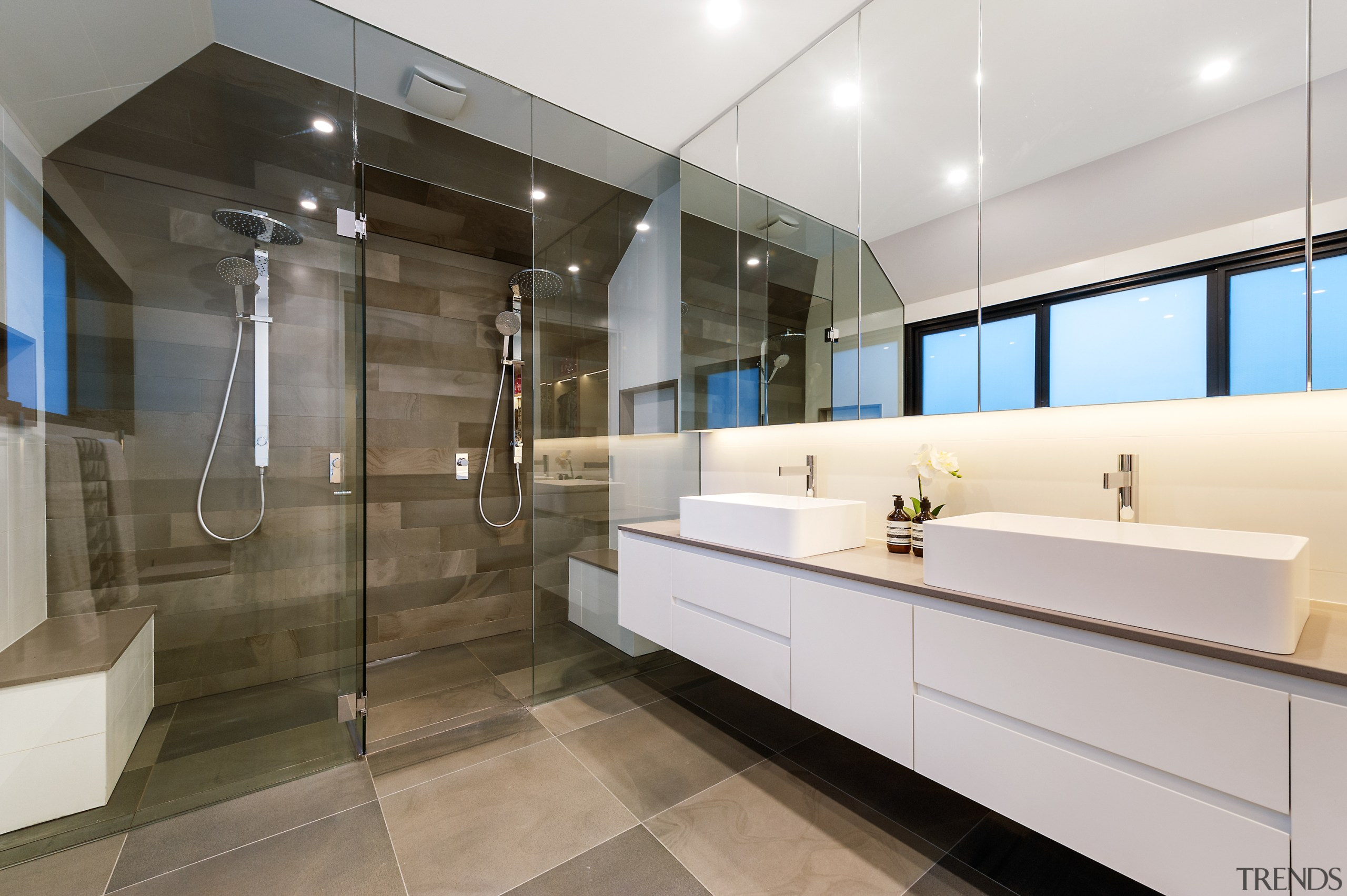 One result of the renovation was a gleaming architecture, bathroom, building, cabinetry, ceiling, design, floor, flooring, furniture, glass, home, house, interior design, lighting, material property, property, real estate, room, tile, wall, white