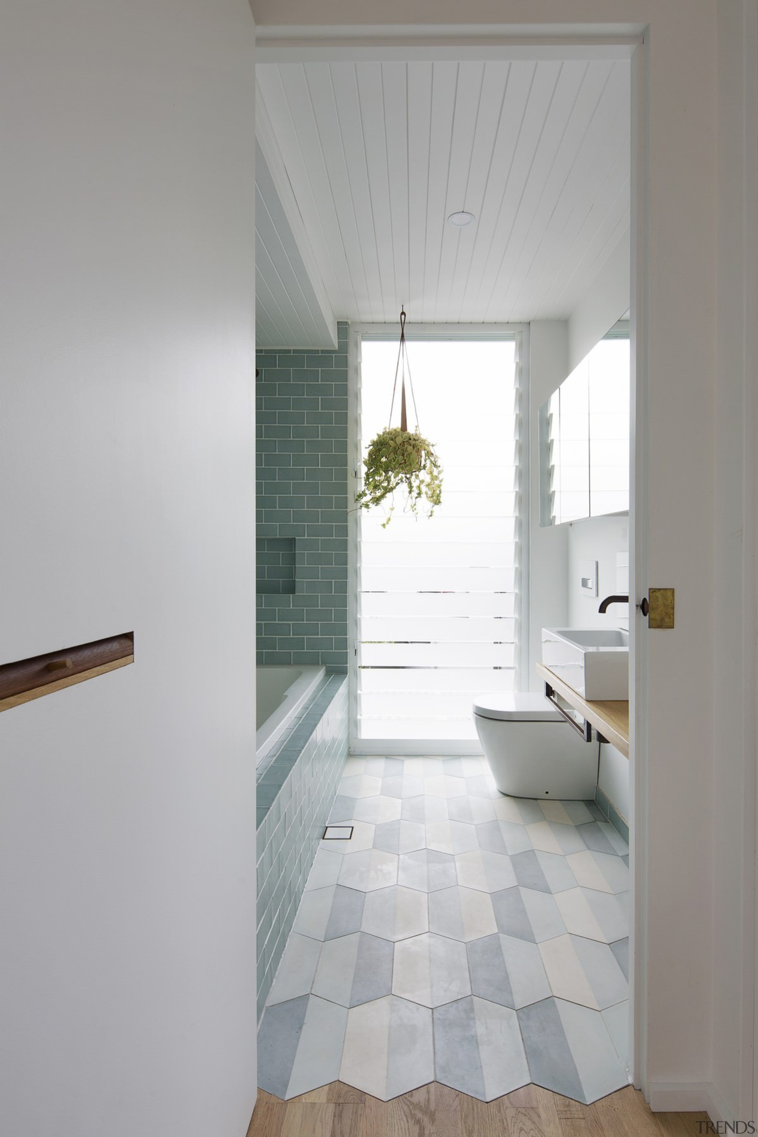 Breaking from convention, the tiles in this bathroom architecture, bathroom, ceiling, daylighting, floor, flooring, home, house, interior design, laminate flooring, room, tile, wall, window, wood flooring, gray