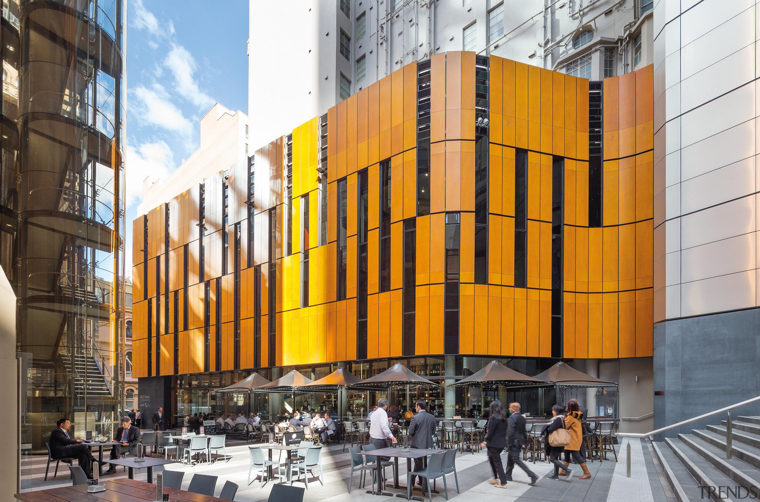 This timber facade curves around the plaza at architecture, building, city, commercial building, facade, metropolis, metropolitan area, mixed use