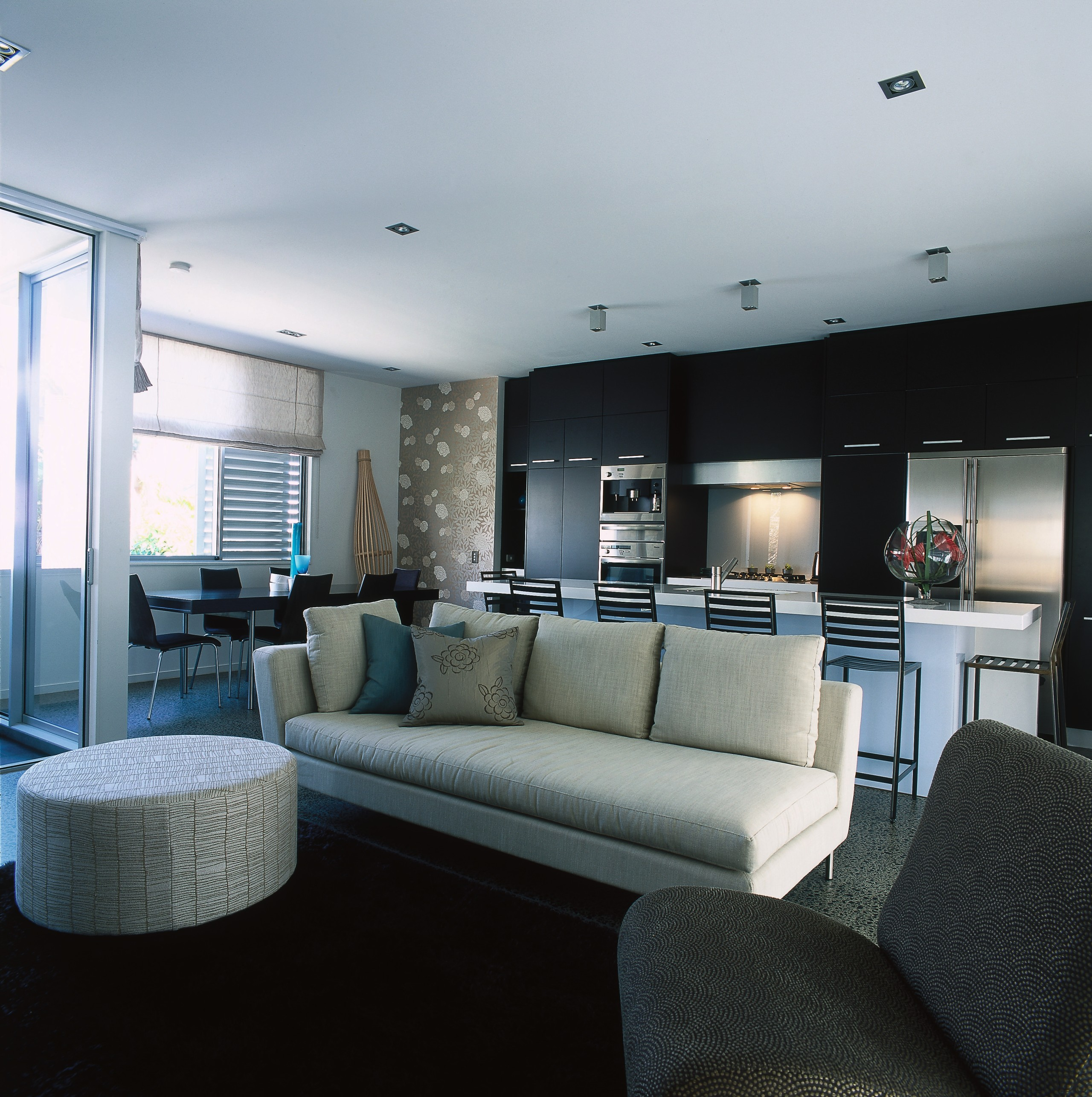 View of the living area - View of apartment, architecture, interior design, living room, property, real estate, room, gray, black