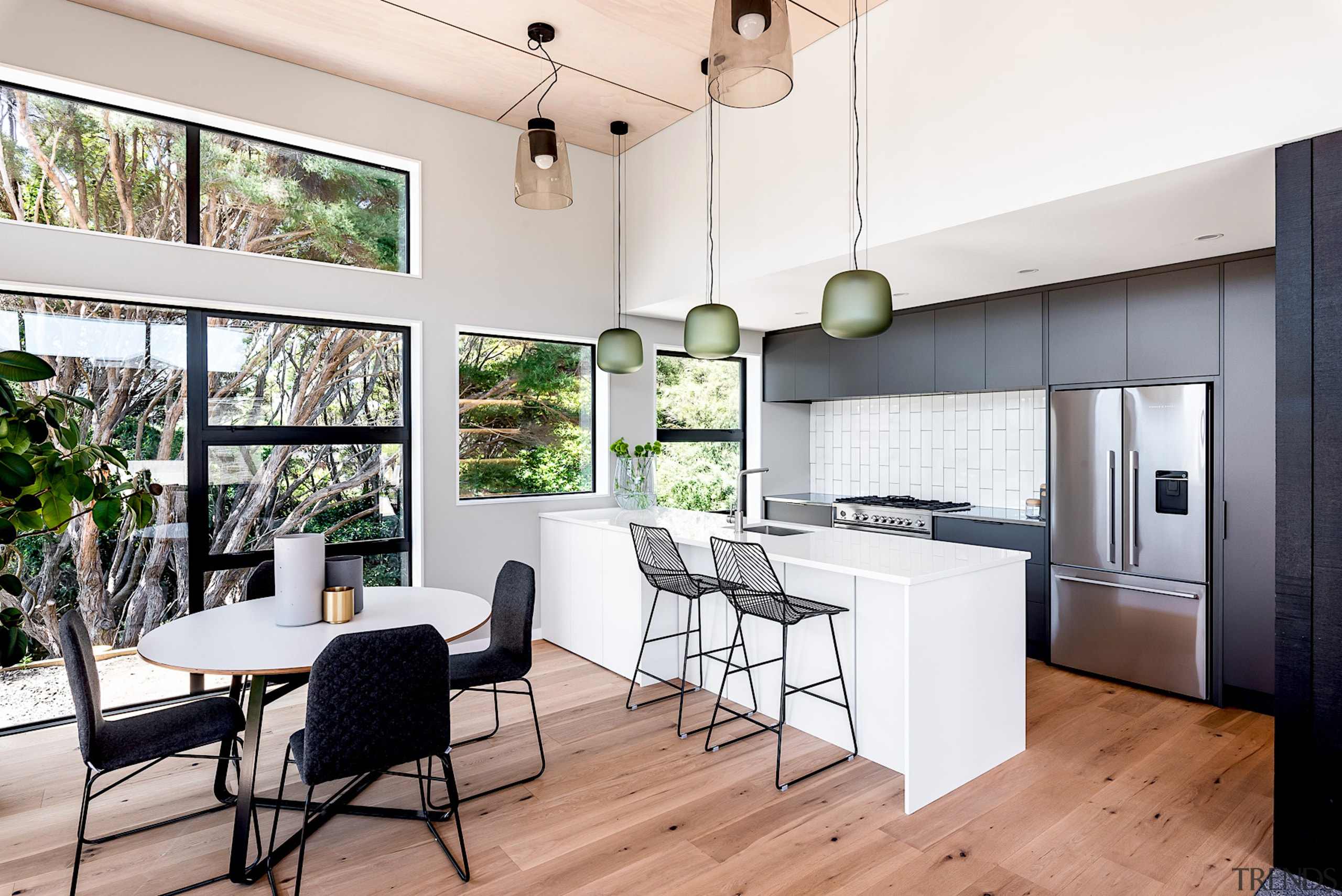 Citta pendants set off the dining and kitchen