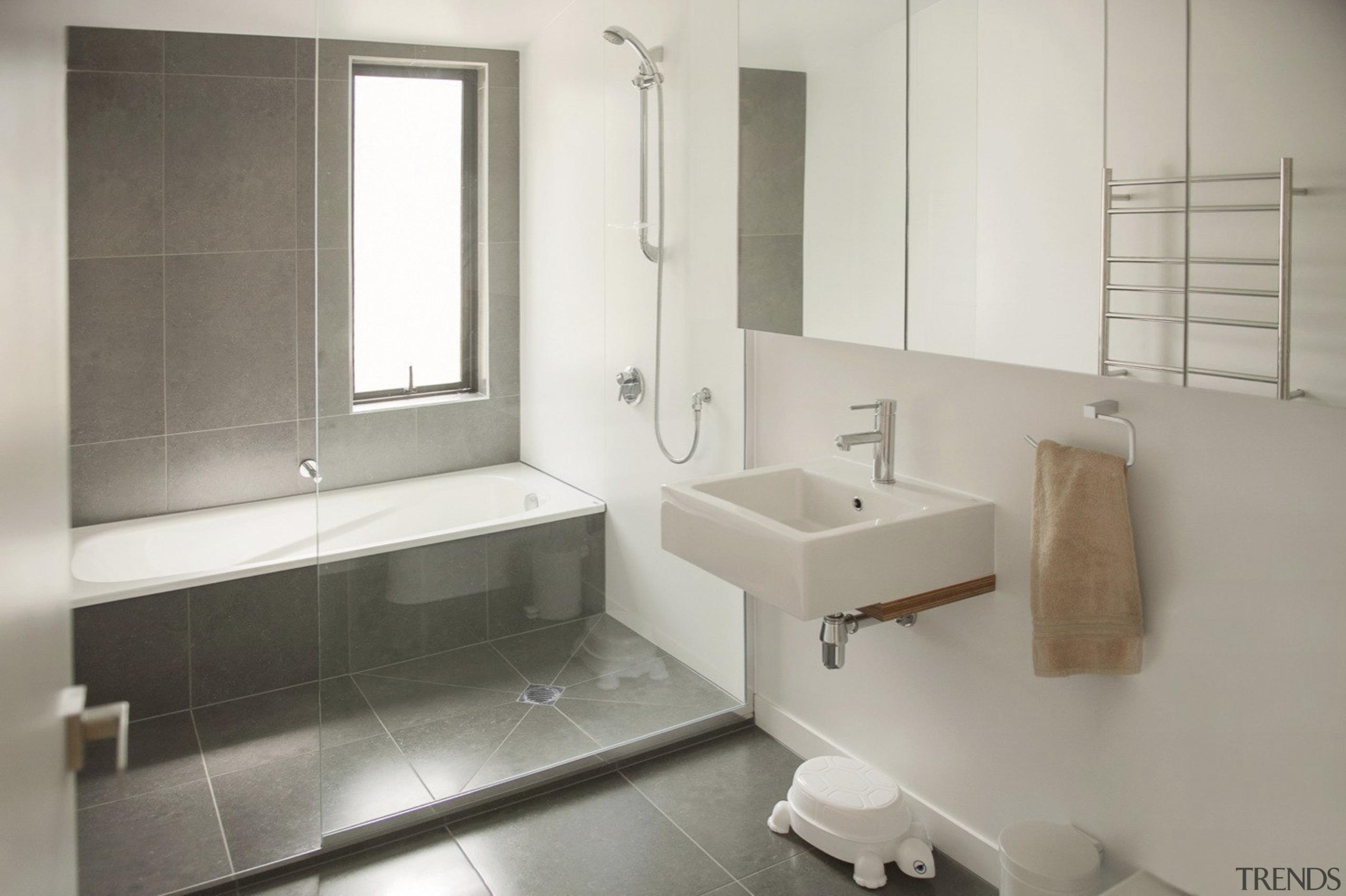 City meets country at Karaka Lakes - City bathroom, bathroom accessory, floor, interior design, plumbing fixture, product design, property, room, sink, tap, tile, gray