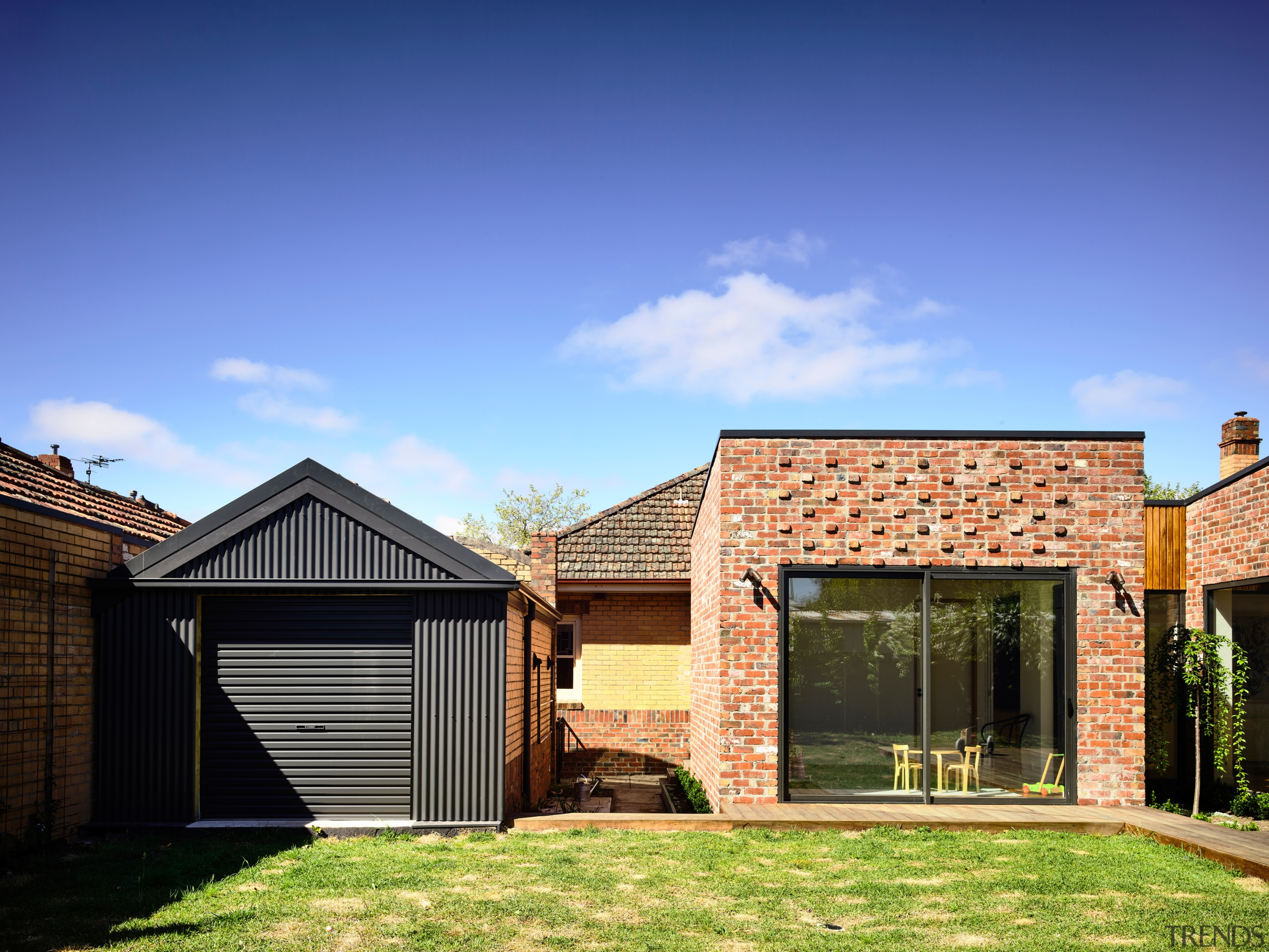 Black corrugated iron on the garage provides a backyard, elevation, facade, home, house, property, residential area, roof, shed, siding, extension, brick, Porter architectur