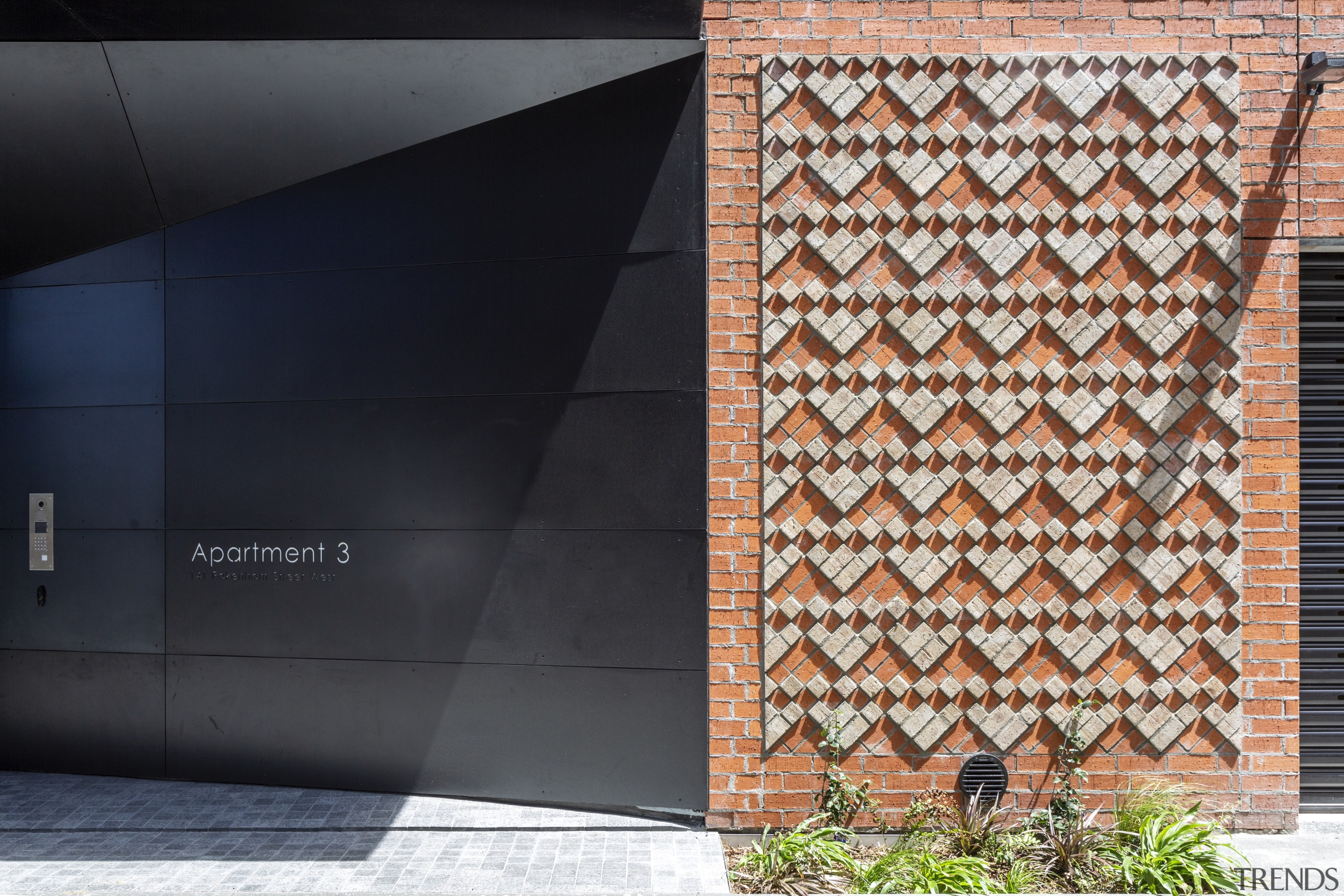 Black and brick predominate on the new Townhouses architecture, design, door, facade, line, pattern, tile, wall, wood, black