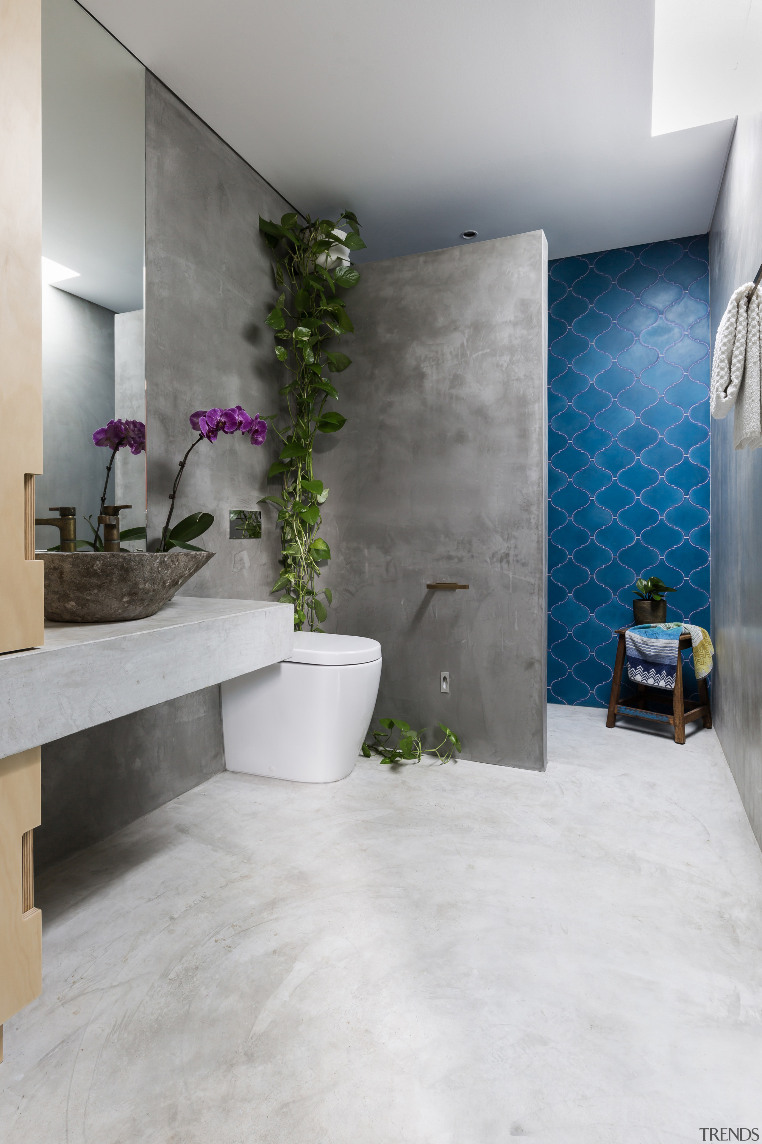 Want a durable, affordable floor that ties in architecture, bathroom, floor, flooring, home, house, interior design, room, tile, wall, gray, white, concrete vanity, Arc Seven
